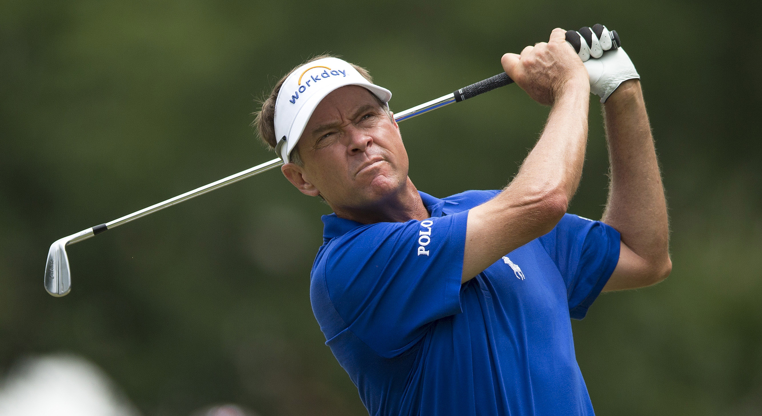 FILE - In this Sunday, Aug. 23, 2015 file photo, Davis Love III tees off on the third hole during the final round of the Wyndham Championship golf tournament at Sedgefield Country Club in Greensboro, N.C. The first golf lesson Davis Love Jr. gave to his s