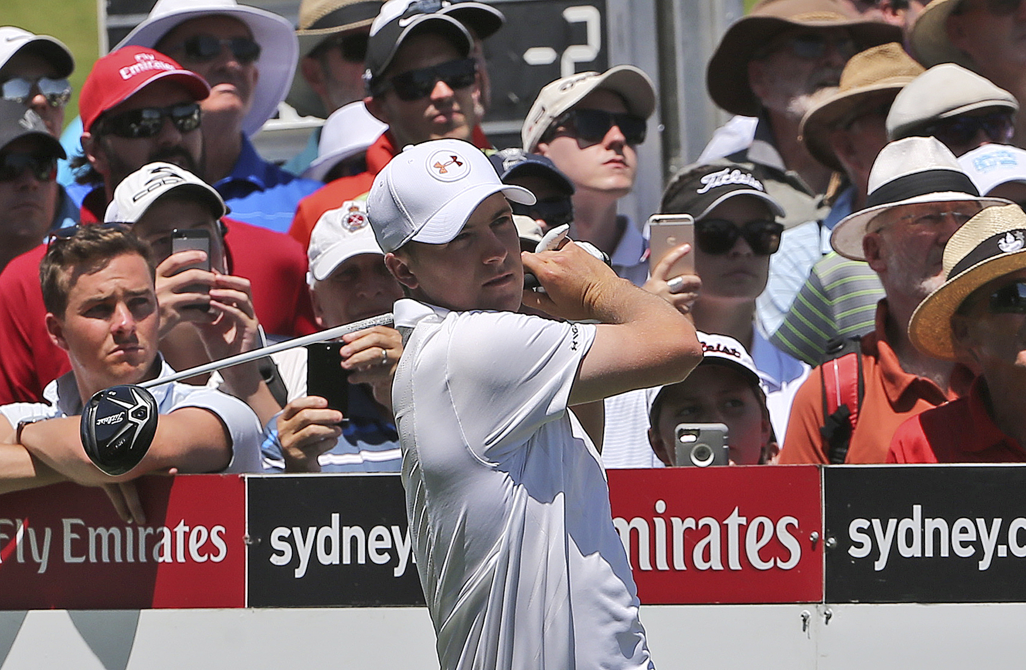 Jordan Spieth of the U.S. tees off on the 8th hole during the Australia Open Golf Tournament in Sydney, Australia, Thursday, Nov. 26, 2015. (AP Photo/Rob Griffith)