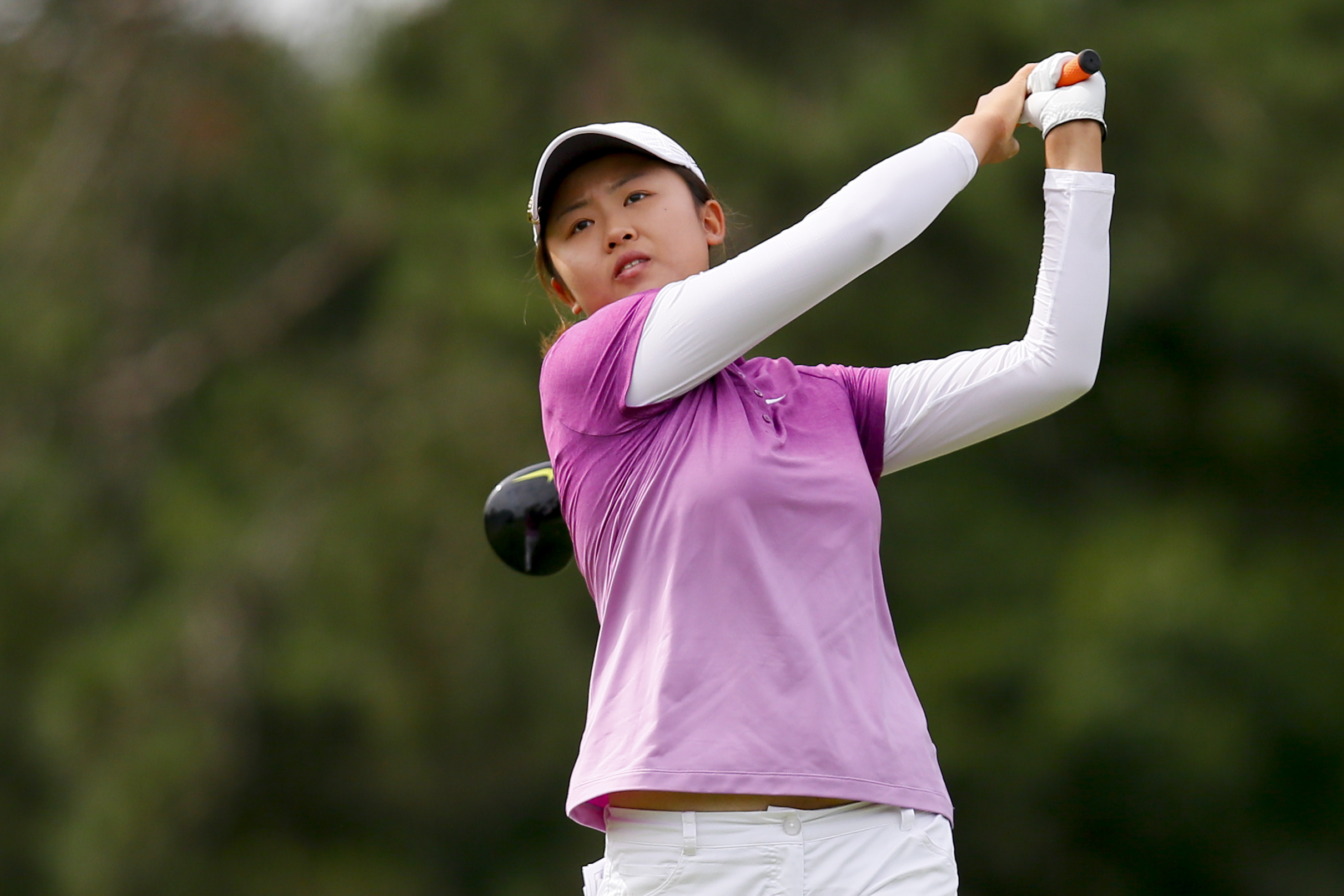 Simin Feng, of China, tees off on the 15th hole during the first round of the Marathon Classic golf tournament at Highland Meadows Golf Club in Sylvania, Ohio, Thursday, July 16, 2015. (AP Photo/Rick Osentoski)