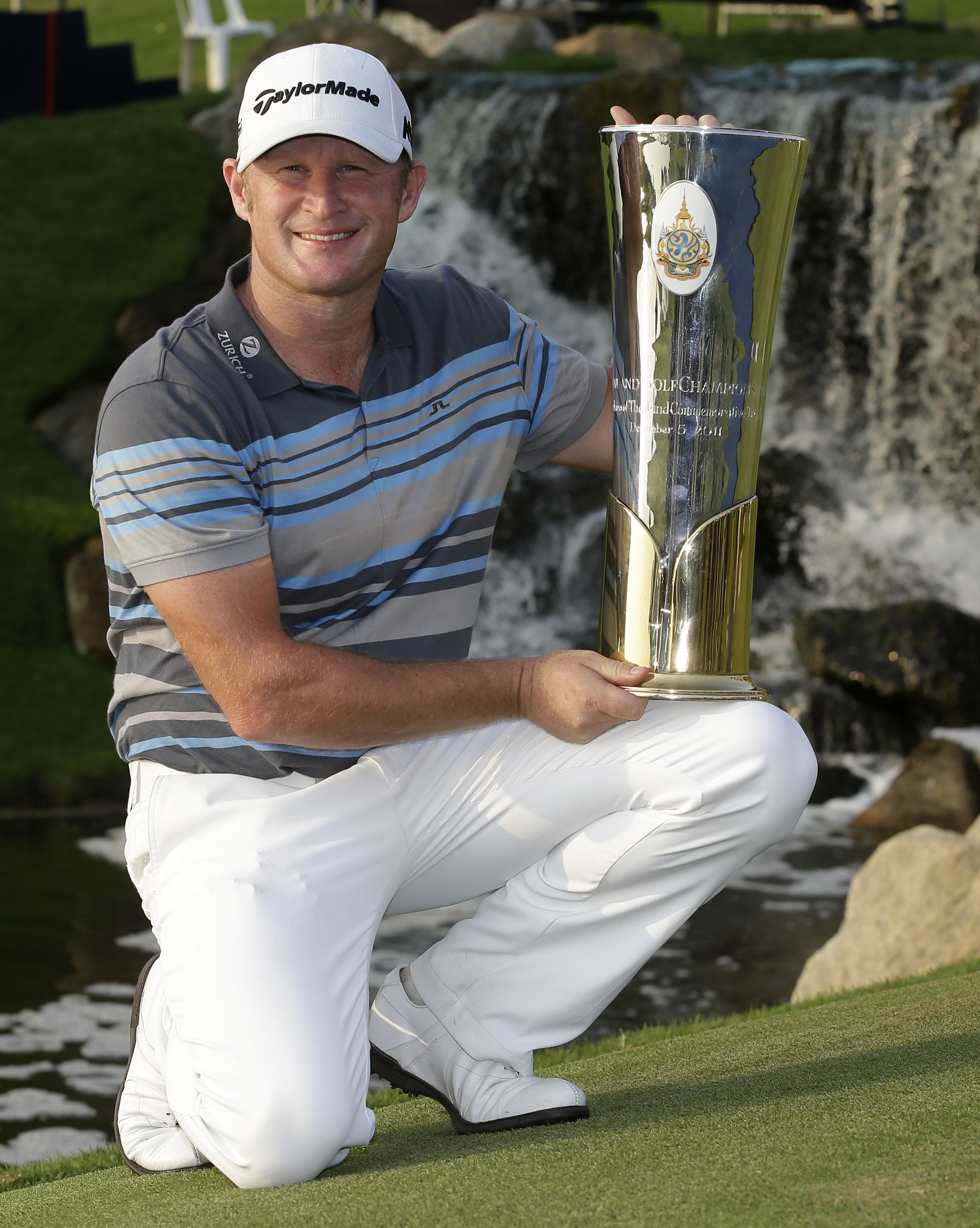Jamie Donaldson of Wales holds his trophy after winning the Thailand Golf Championship at the Amata Spring Country Club, Chonburi, Thailand, Sunday, Dec. 13, 2015. (AP Photo/Mark Baker)