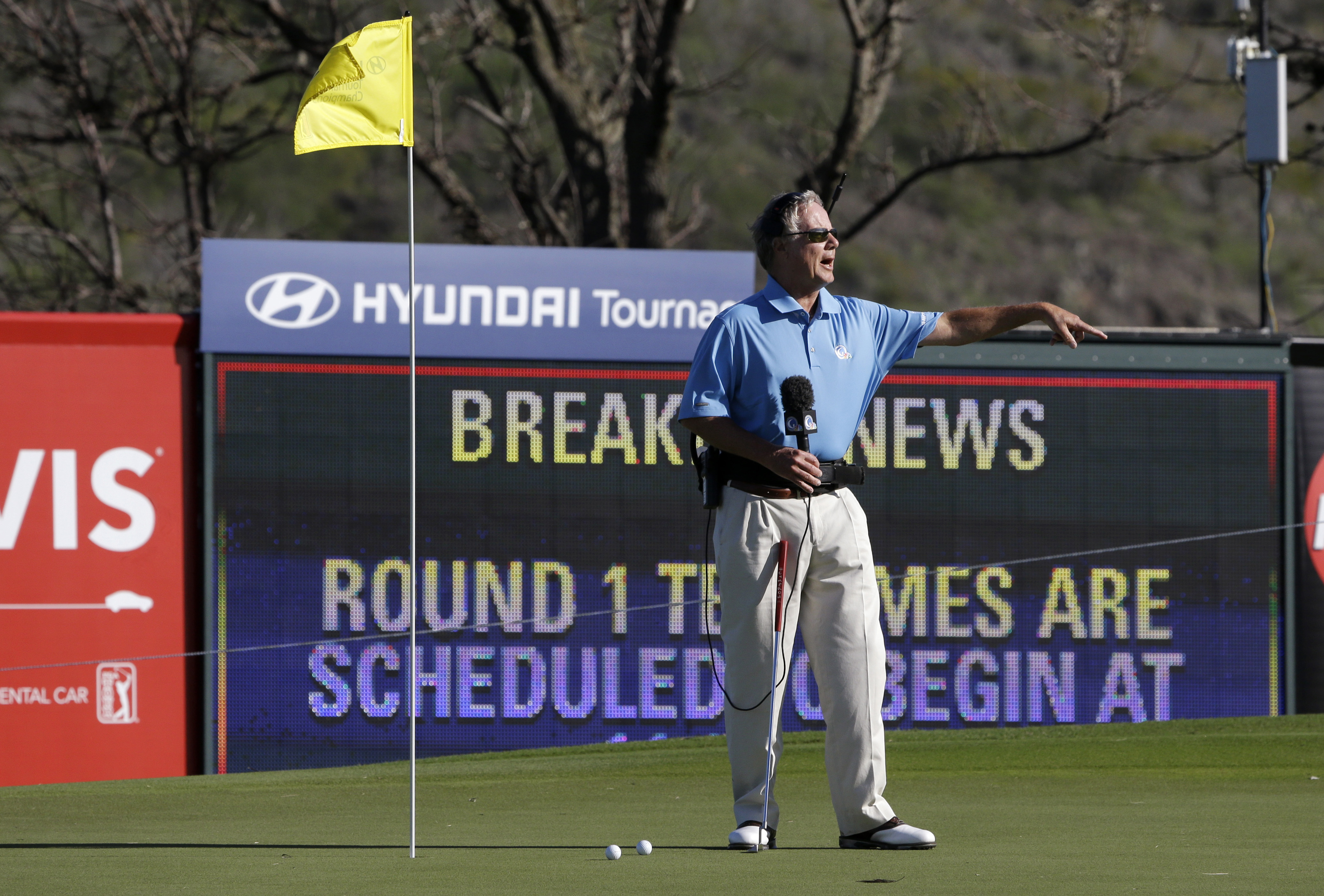 FILE - This Jan. 6, 2013, file photo shows broadcast analyst Mark Rolfing talking about the wind from the 10th green before the first round at the Tournament of Champions PGA golf tournament, in Kapalua, Hawaii. Five months after he was diagnosed with a r