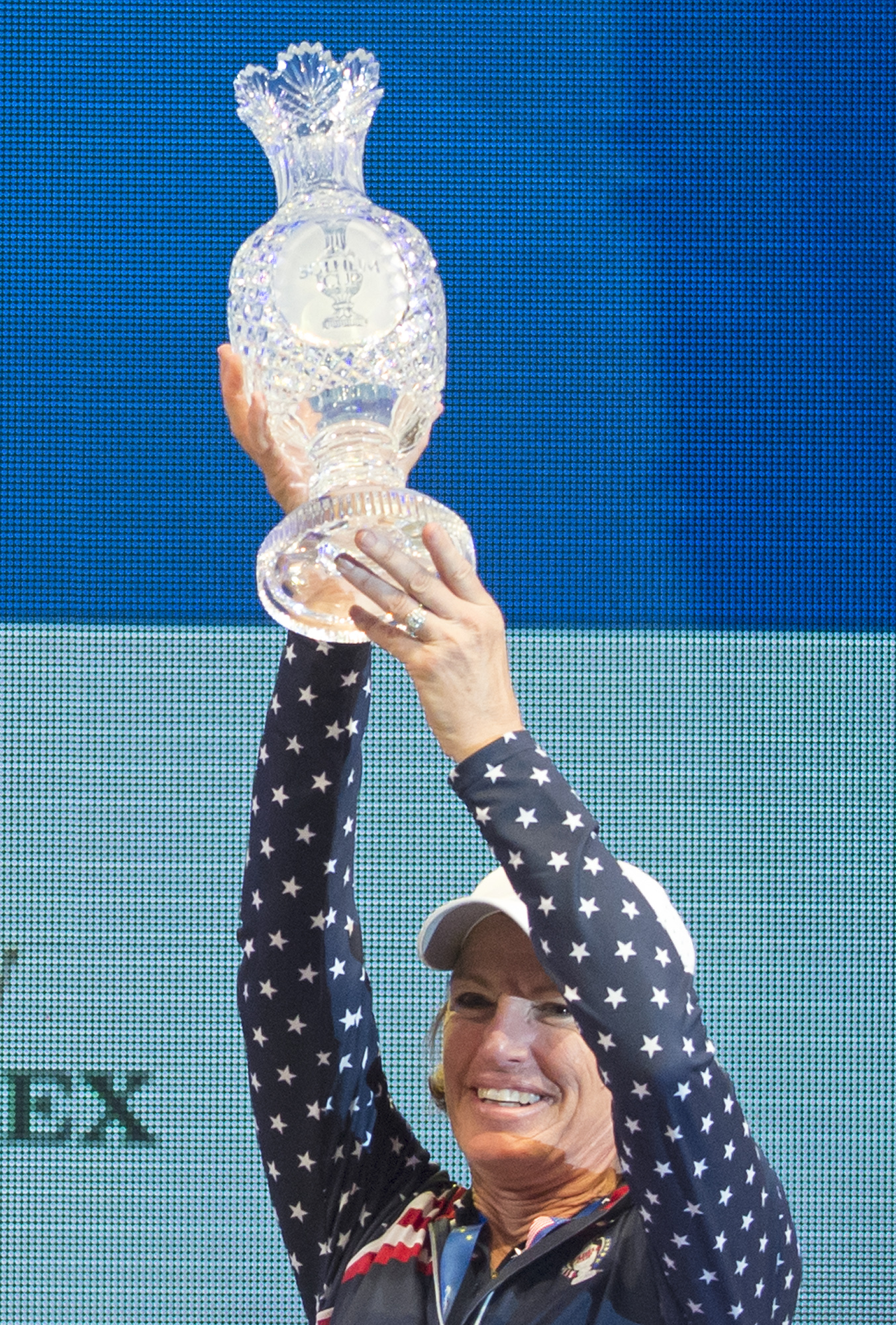 Juli Inkster, team captain of the United States, holds the trophy during the award ceremony at the Solheim Cup golf tournament in St. Leon-Rot, southern Germany, Sunday, Sept. 20, 2015. U.S. Paula Creamer defeated Germany's Sandra Gal to complete a remark