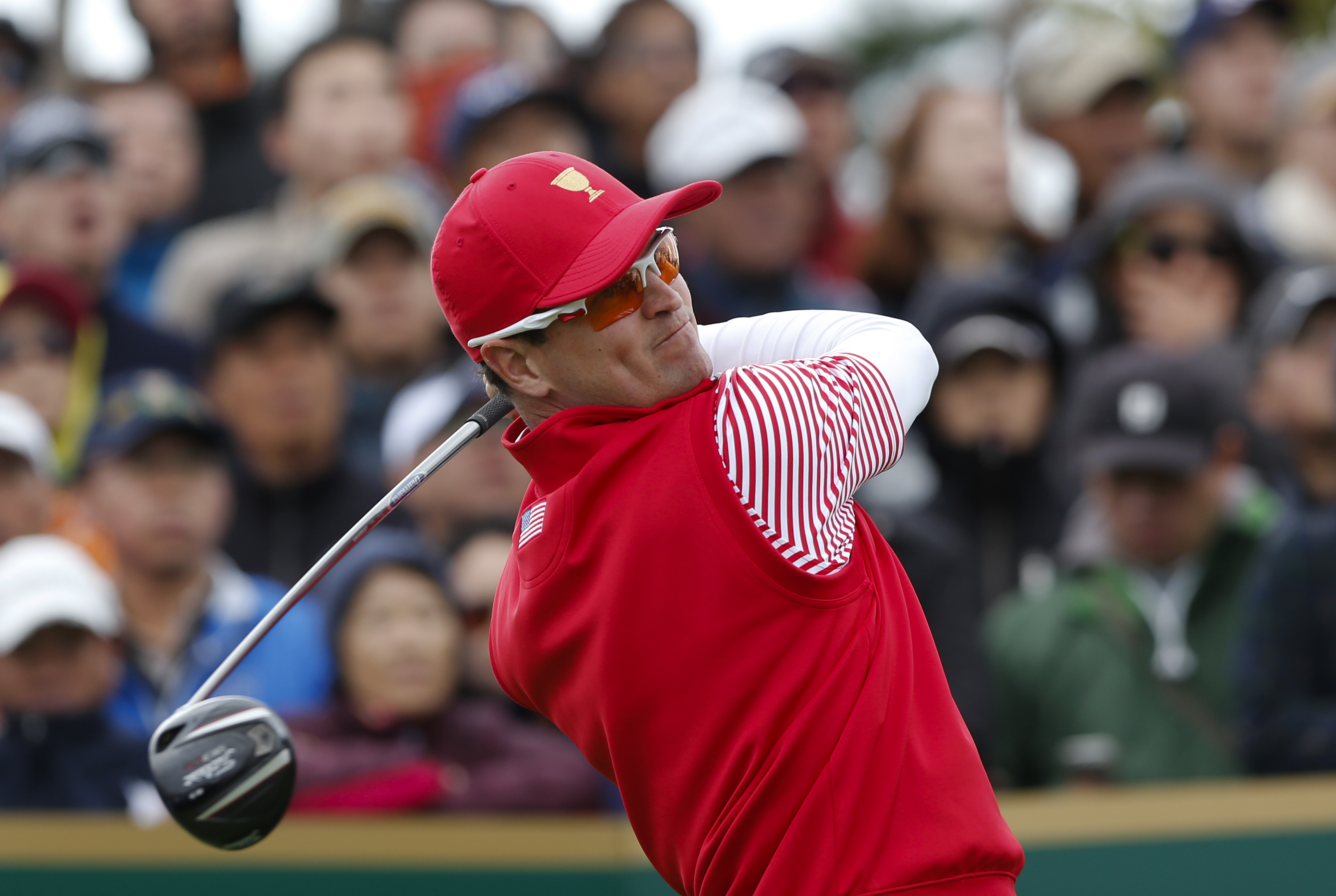 FILE - In this Oct. 11, 2015, file photo, United States' Zach Johnson watches his tee shot on the 12th hole during his singles match against International team player Jason Day of Australia at the Presidents Cup on the Jack Nicklaus Golf Club Korea, in In