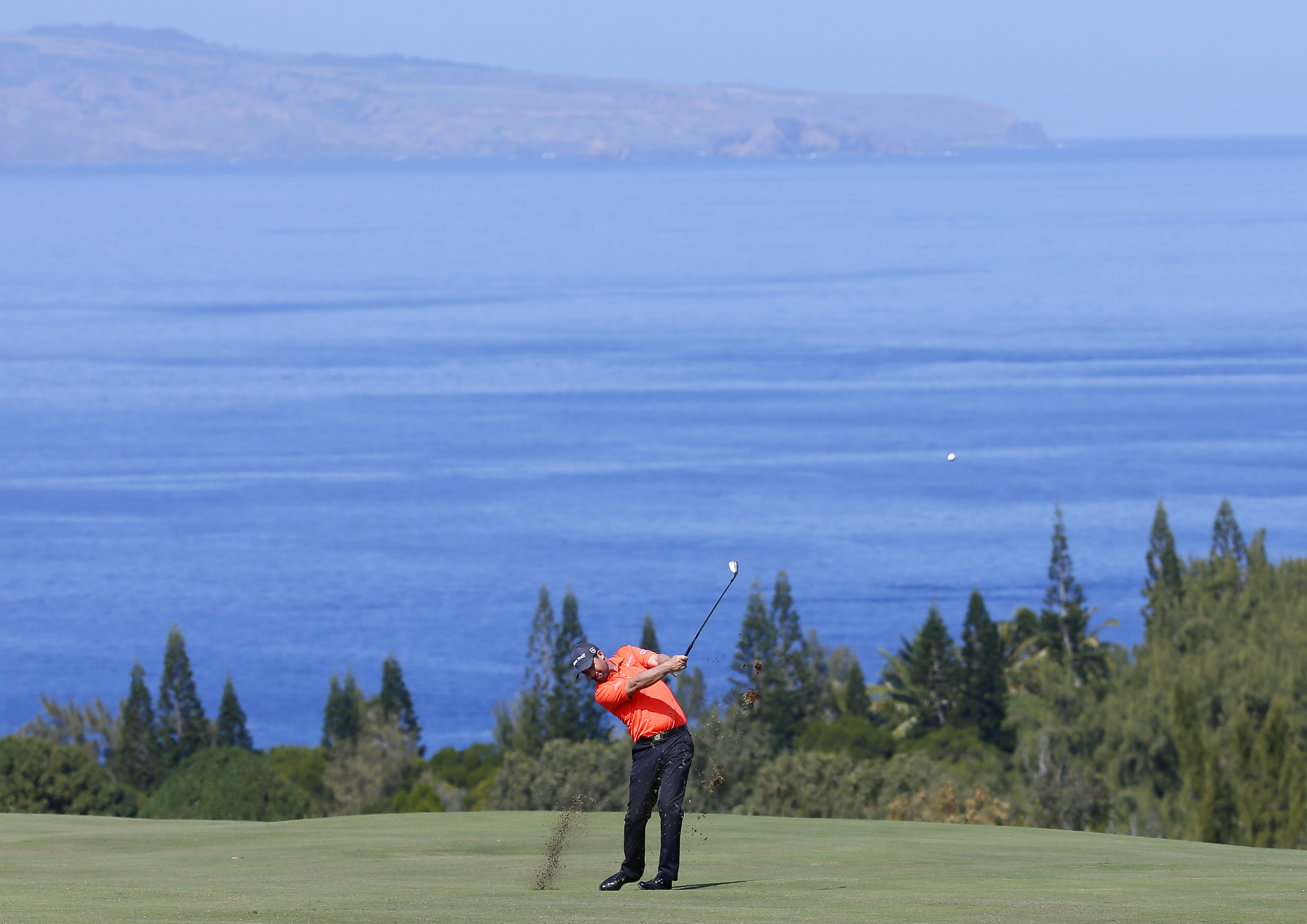 Padraig Harrington hits from the fourth fairway during the second round of the Tournament of Champions golf event Friday, Jan. 8, 2016, at Kapalua Plantation Course in Kapalua, Hawaii. (AP Photo/Matt York)