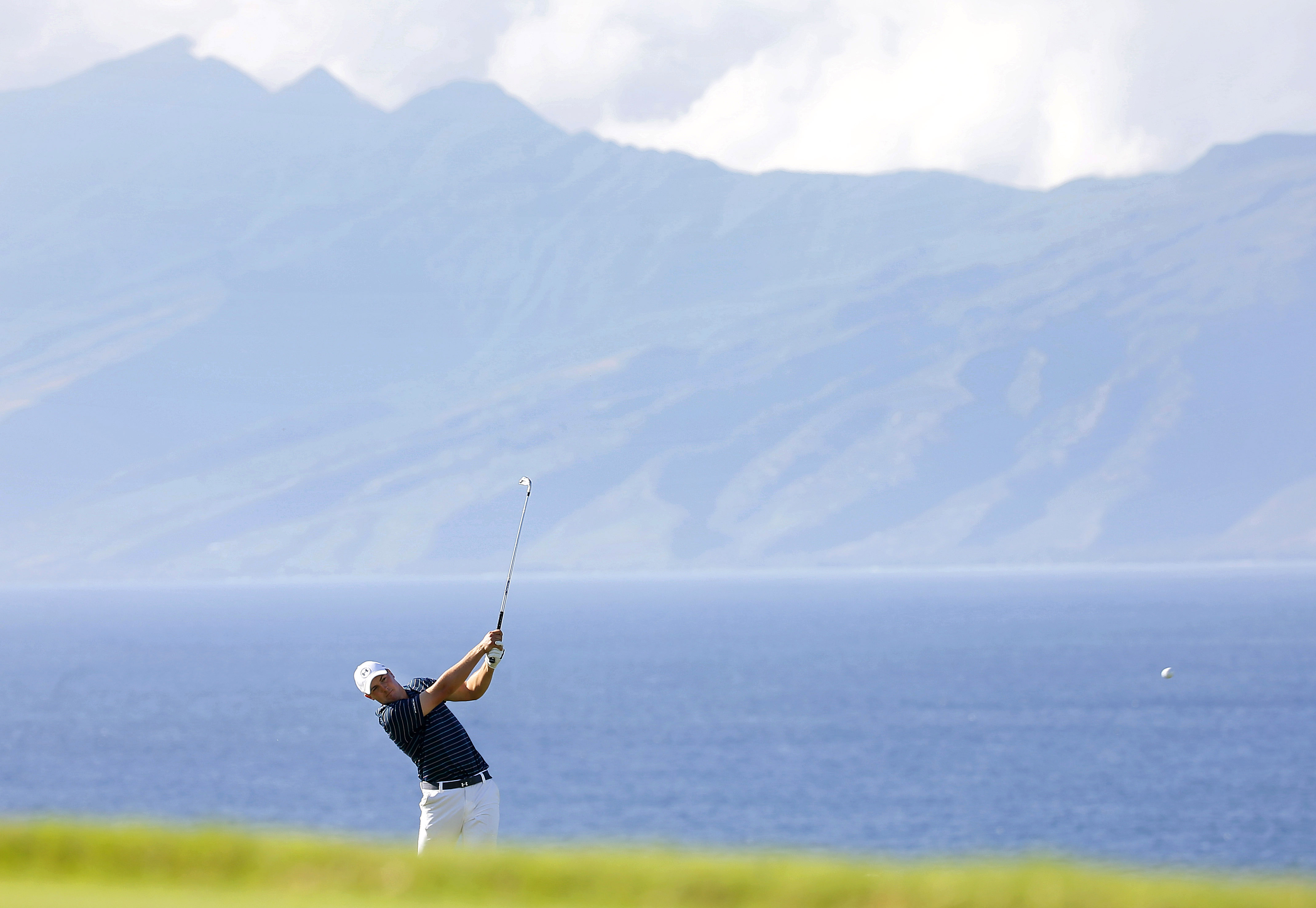 Jordan Spieth hits on the 13th tee during the final round of the Tournament of Champions golf event Sunday, Jan. 10, 2016, at Kapalua Plantation Course in Kapalua, Hawaii.(AP Photo/Matt York)