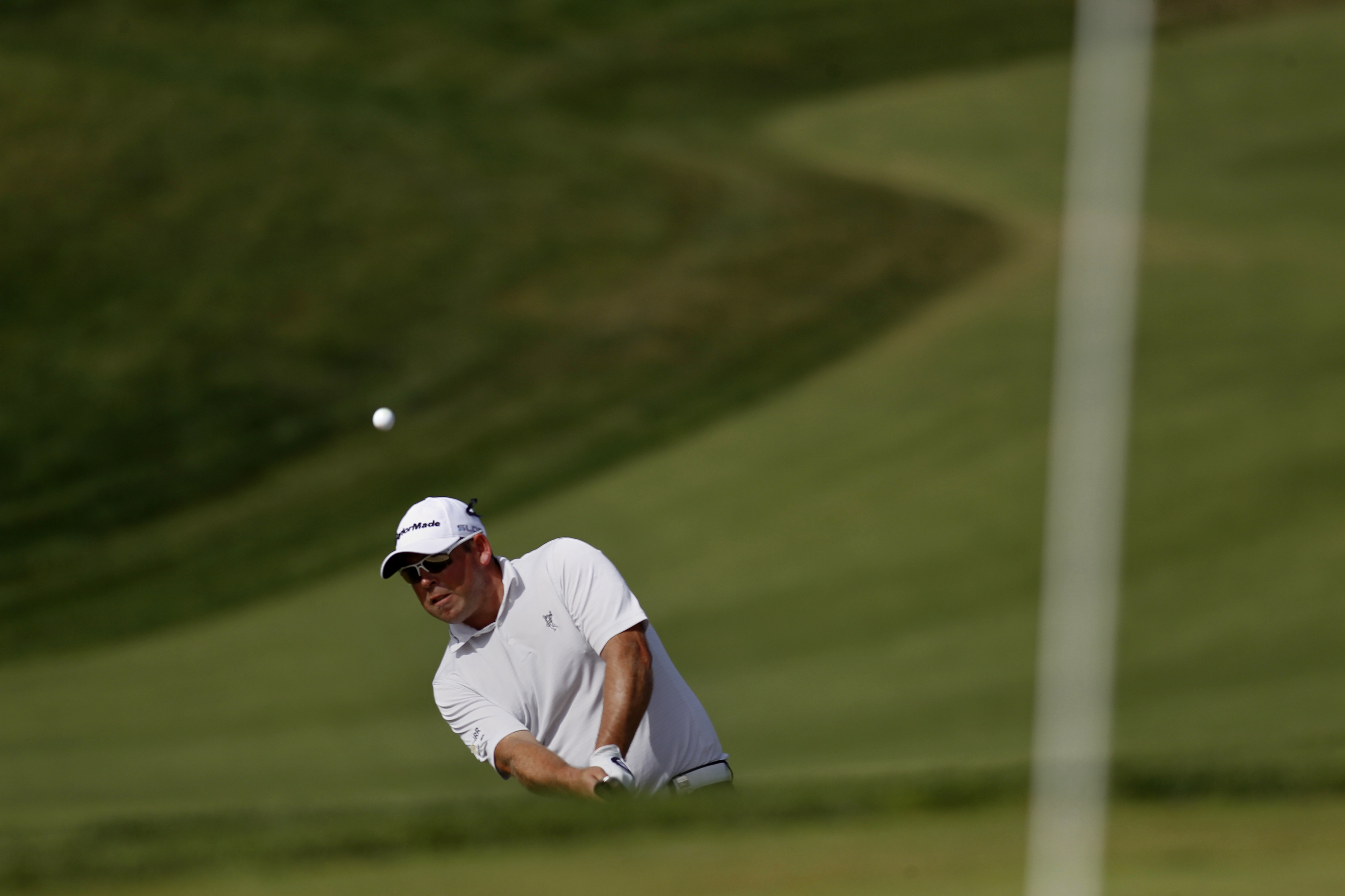 South Africa's Justin Walters chips the ball onto the seventh hole during the third round of the Portugal Master golf tournament at the Victoria golf course in Vilamoura, southern Portugal, Saturday, Oct. 12, 2013. (AP Photo/Francisco Seco)