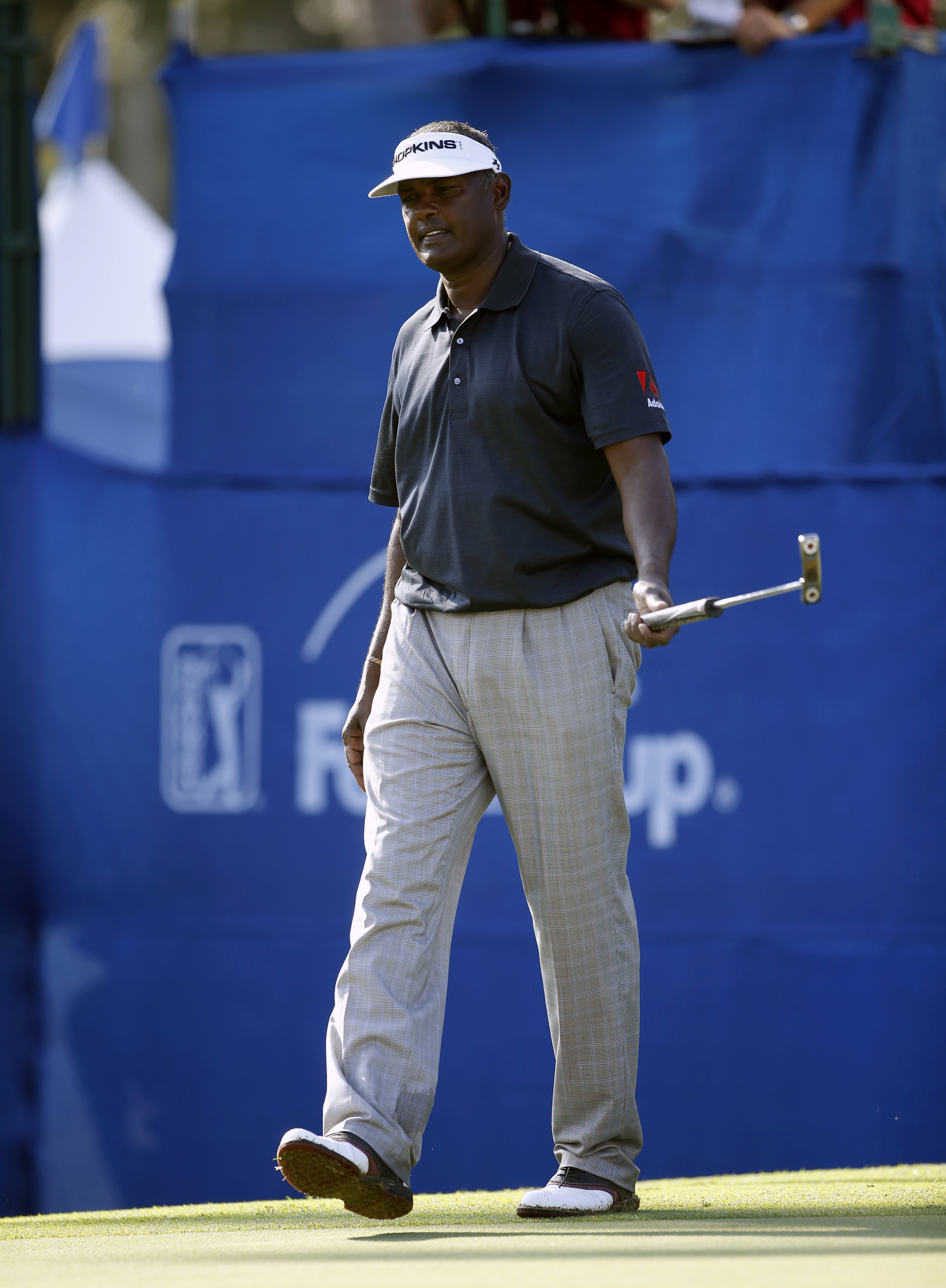 Vijay Singh, of the Fiji Islands, reacts to his putt on the 18th green during the first round of the Sony Open golf tournament, Thursday, Jan. 14, 2016, in Honolulu. (AP Photo/Marco Garcia)