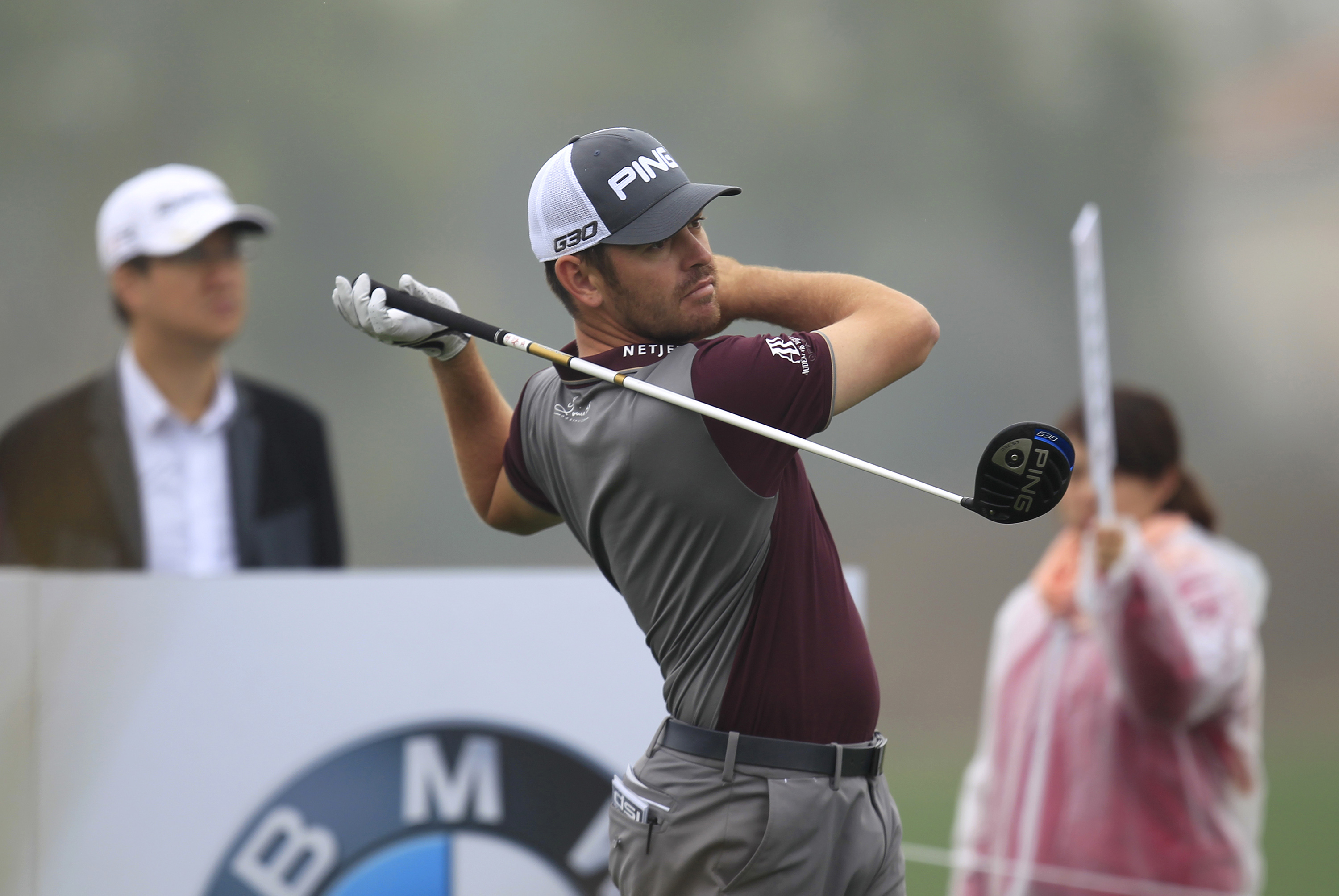 Louis Oosthuizen of South Africa tees off on the 15th hole during the first round of the BMW Masters golf tournament at the Lake Malaren Golf Club in Shanghai, China Thursday, Nov. 12, 2015. (AP Photo)