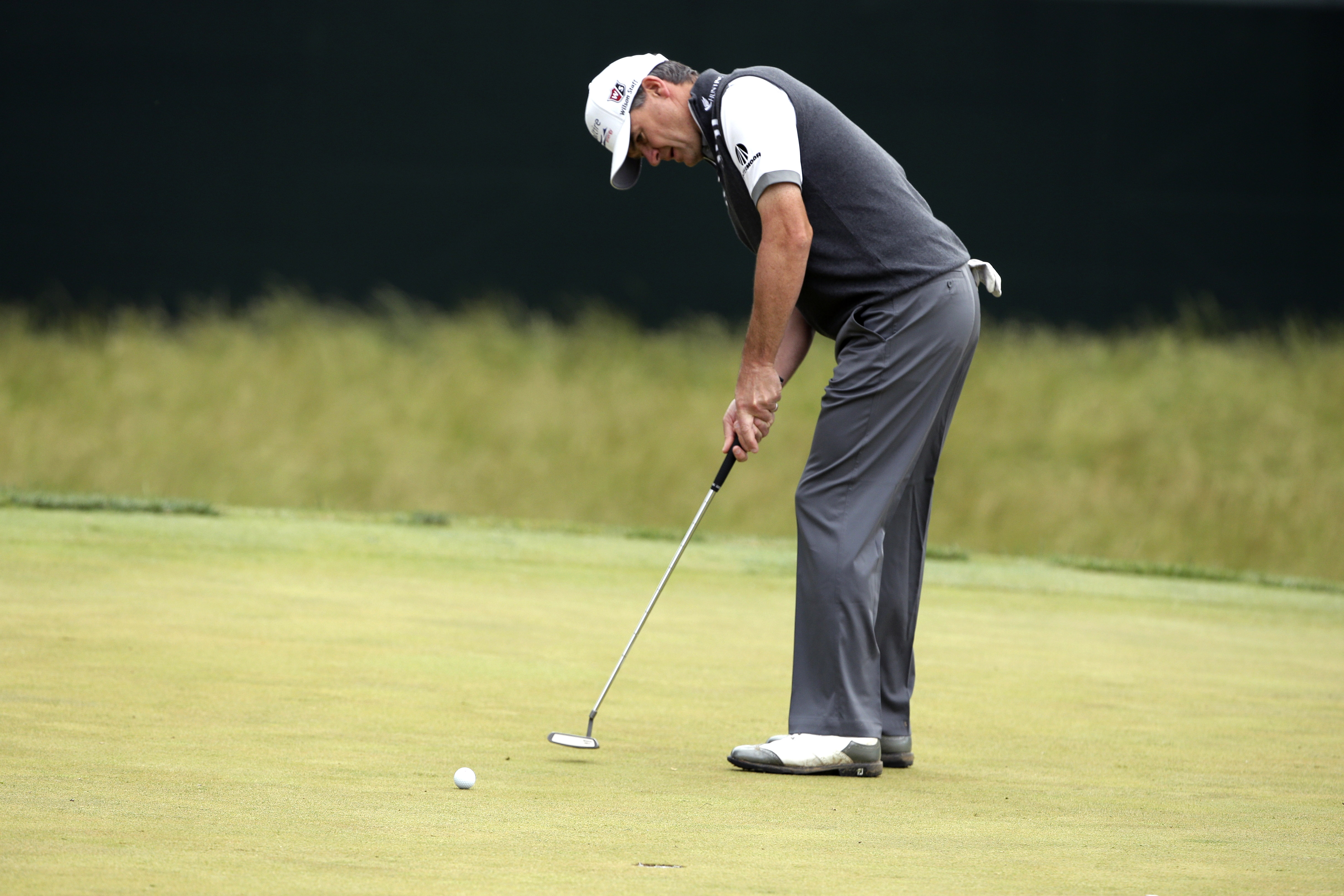 Paul Lawrie, of Scotland, putts on the 13th hole during the second round of the U.S. Open golf tournament at Merion Golf Club, Friday, June 14, 2013, in Ardmore, Pa. (AP Photo/Charlie Riedel)