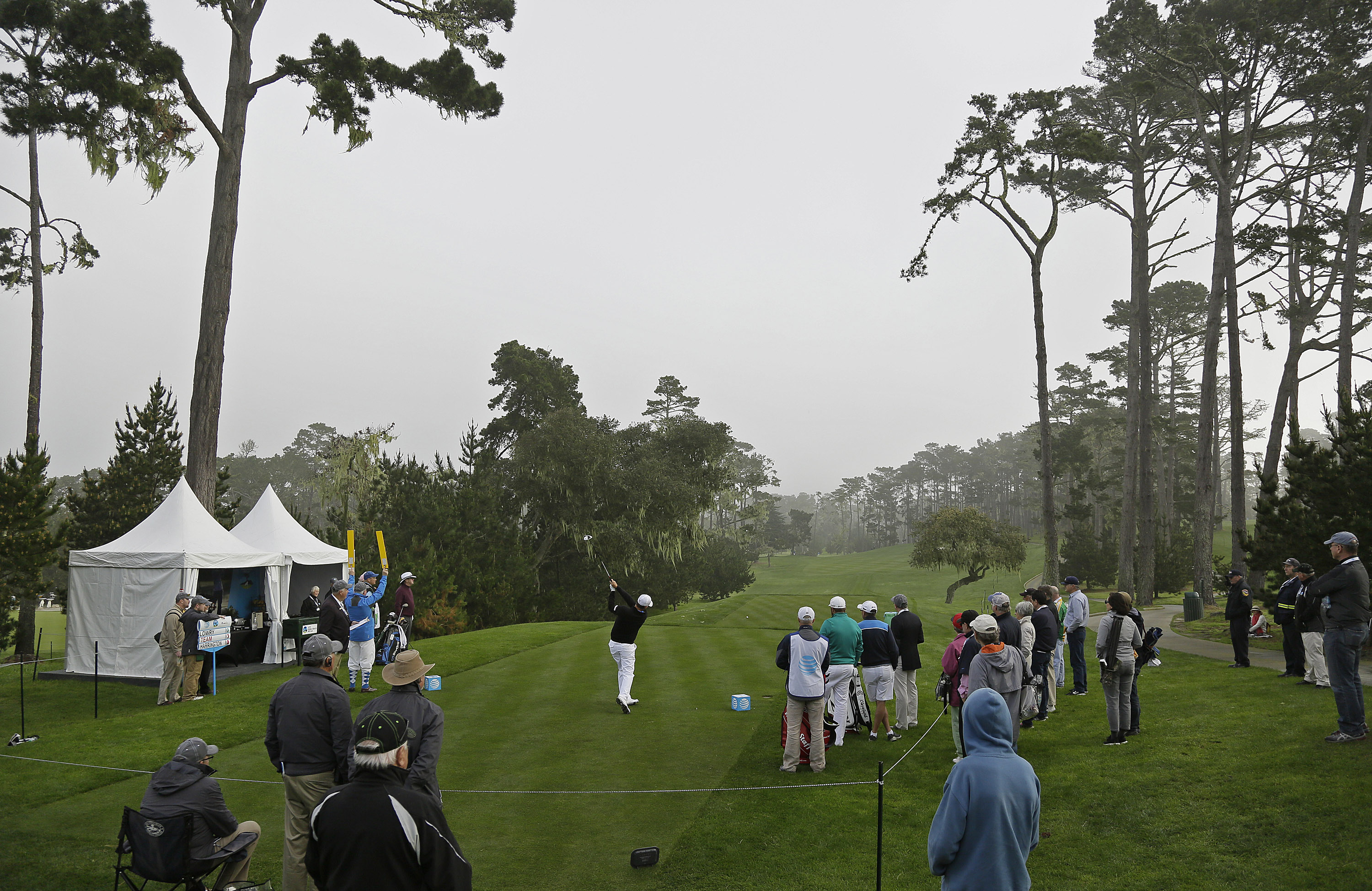 Padraig Harrington, of Ireland, hits from the 10th tee of the Spyglass Hill Golf Course during the third round of the AT&T Pebble Beach National Pro-Am golf tournament Saturday, Feb. 13, 2016, in Pebble Beach, Calif. (AP Photo/Eric Risberg)