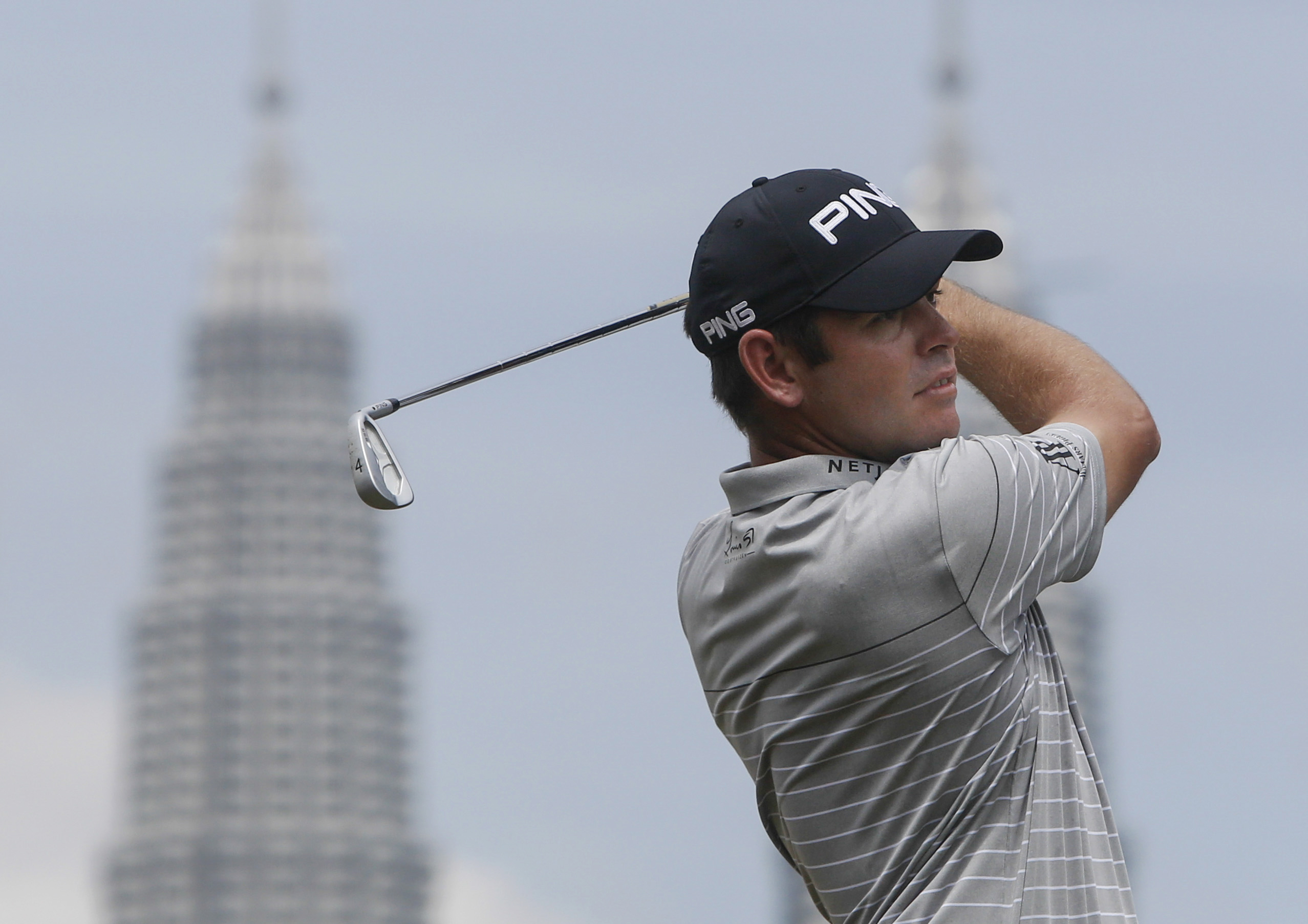 Louis Oosthuizen of South Africa follows his shot from the tenth hole during the third round of the Maybank Championship golf tournament in Kuala Lumpur, Malaysia, on Saturday, Feb. 20, 2016. (AP Photo/Joshua Paul)