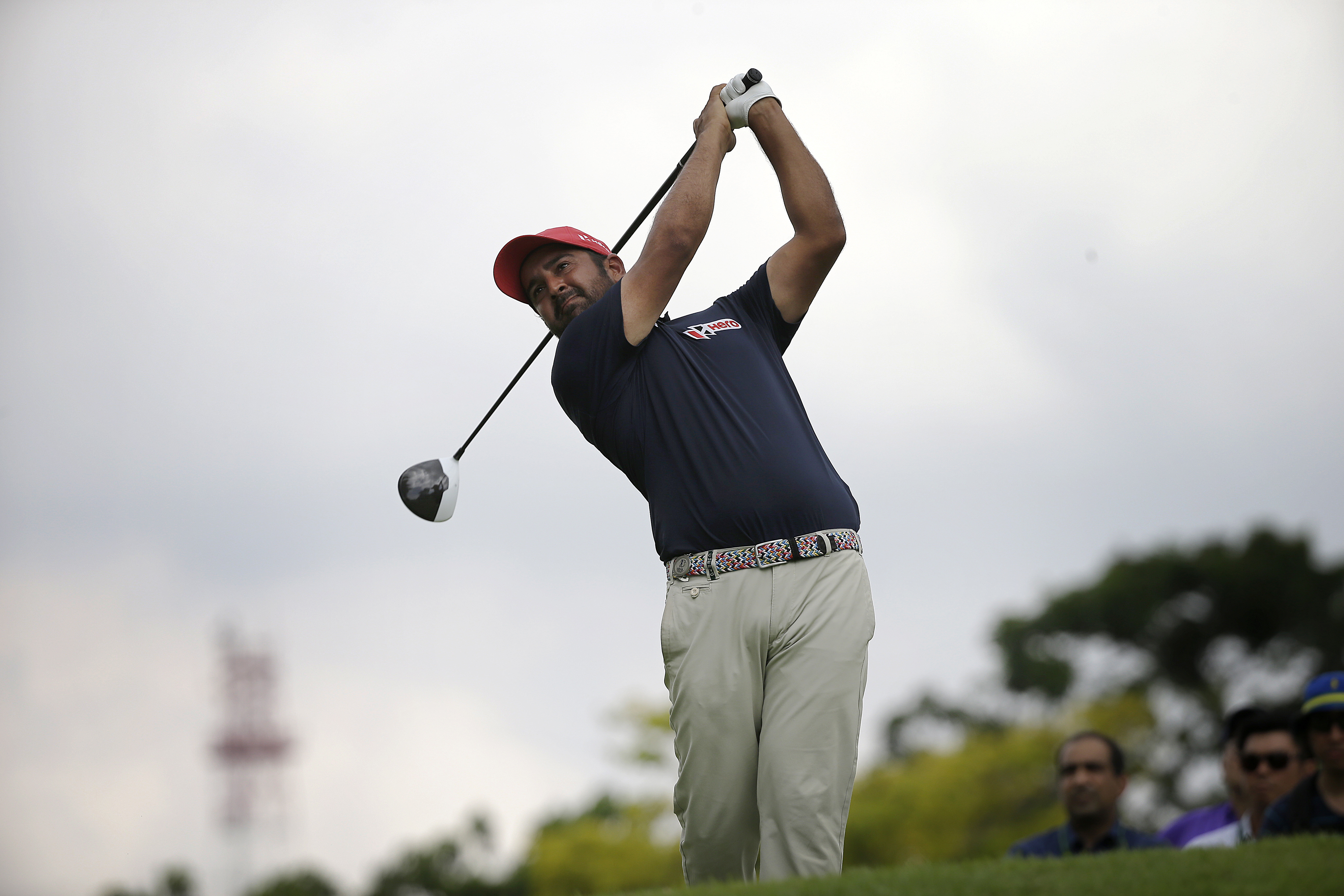 Shiv Kapur of India tees off on the 18th hole during the first round of the SMBC Singapore Open golf tournament at the Sentosa Golf Club's Serapong Course on Thursday, Jan. 28, 2016, in Singapore. (AP Photo/Wong Maye-E)