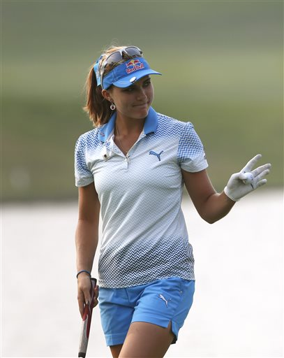 Winner Lexi Thompson of the United States acknowledges spectators on the 18th hole during the final round of the LPGA KEB Hana Bank Championship golf tournament at Sky72 Golf Club in Incheon, South Korea, Sunday, Oct. 18, 2015. (AP Photo/Lee Jin-man)