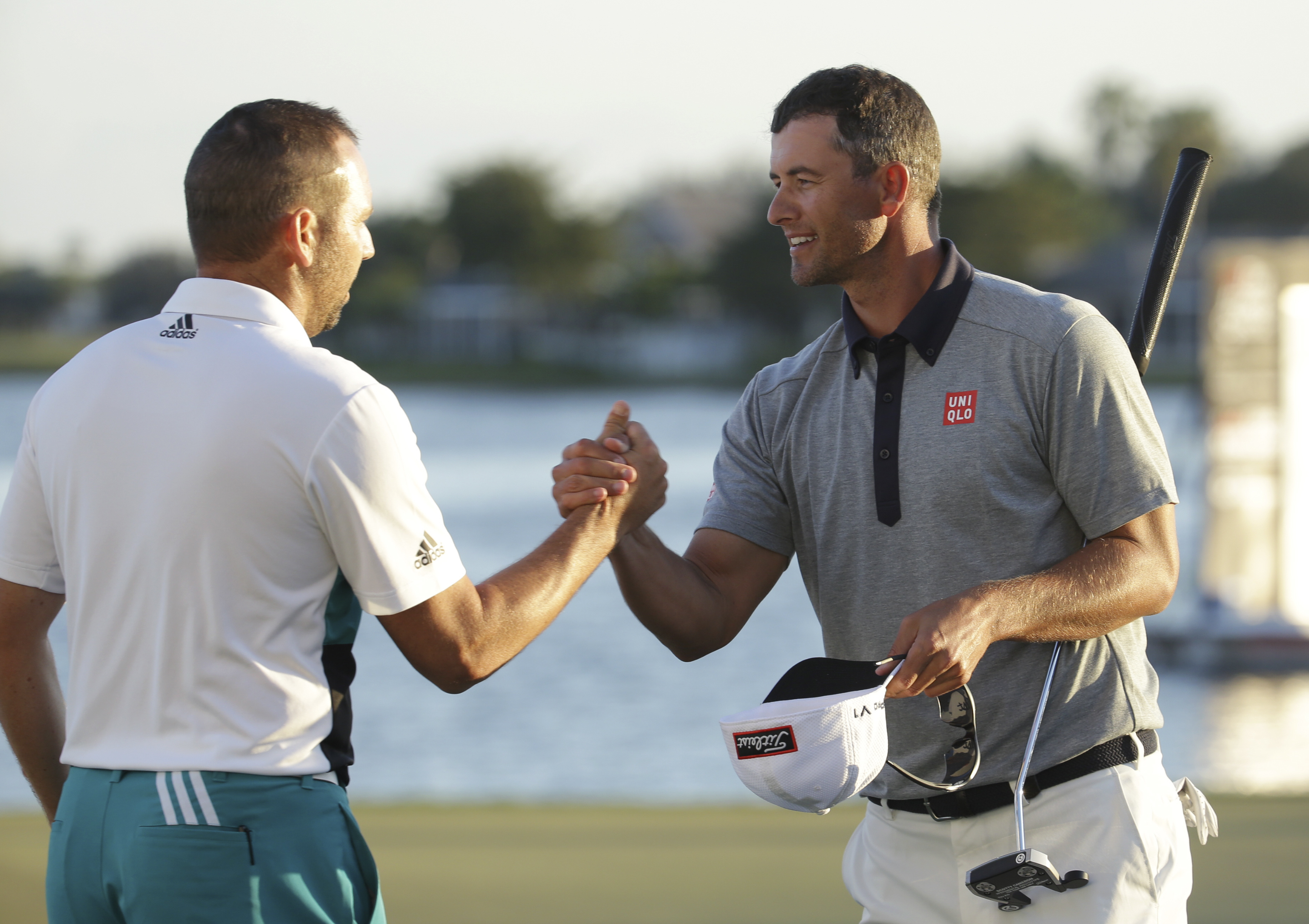 Sergio Garcia, of Spain, left, shakes hands with Adam Scott, of Australia, right, after the third round of the Honda Classic golf tournament, Saturday, Feb. 27, 2016, in Palm Beach Gardens, Fla. (AP Photo/Lynne Sladky)