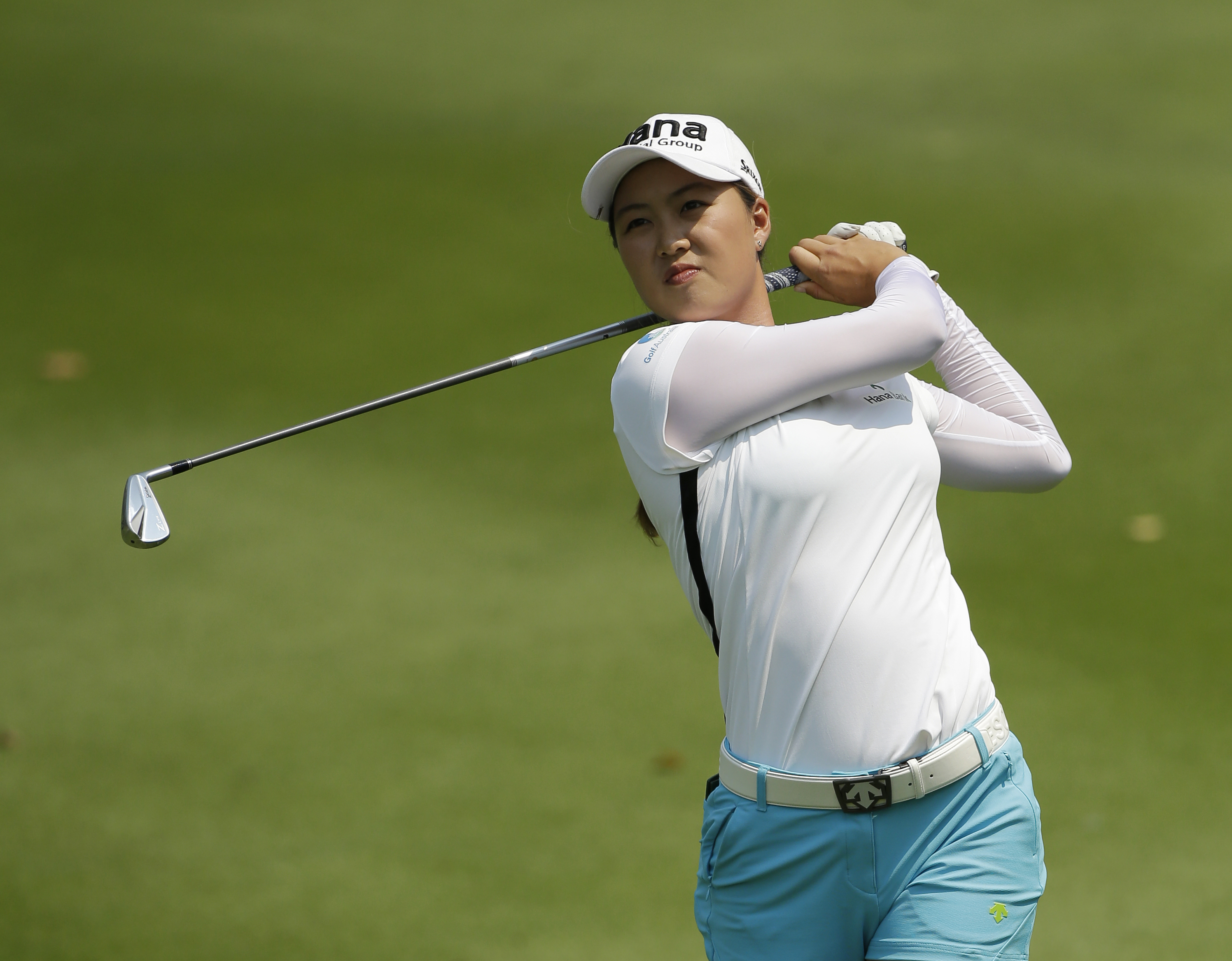 Minjee Lee of Australia plays a shot from a fairway on 9th during the final round of the LPGA Thailand golf tournament in Pattaya, southern Thailand, Sunday, Feb. 28, 2016. (AP Photo/Sakchai Lalit)