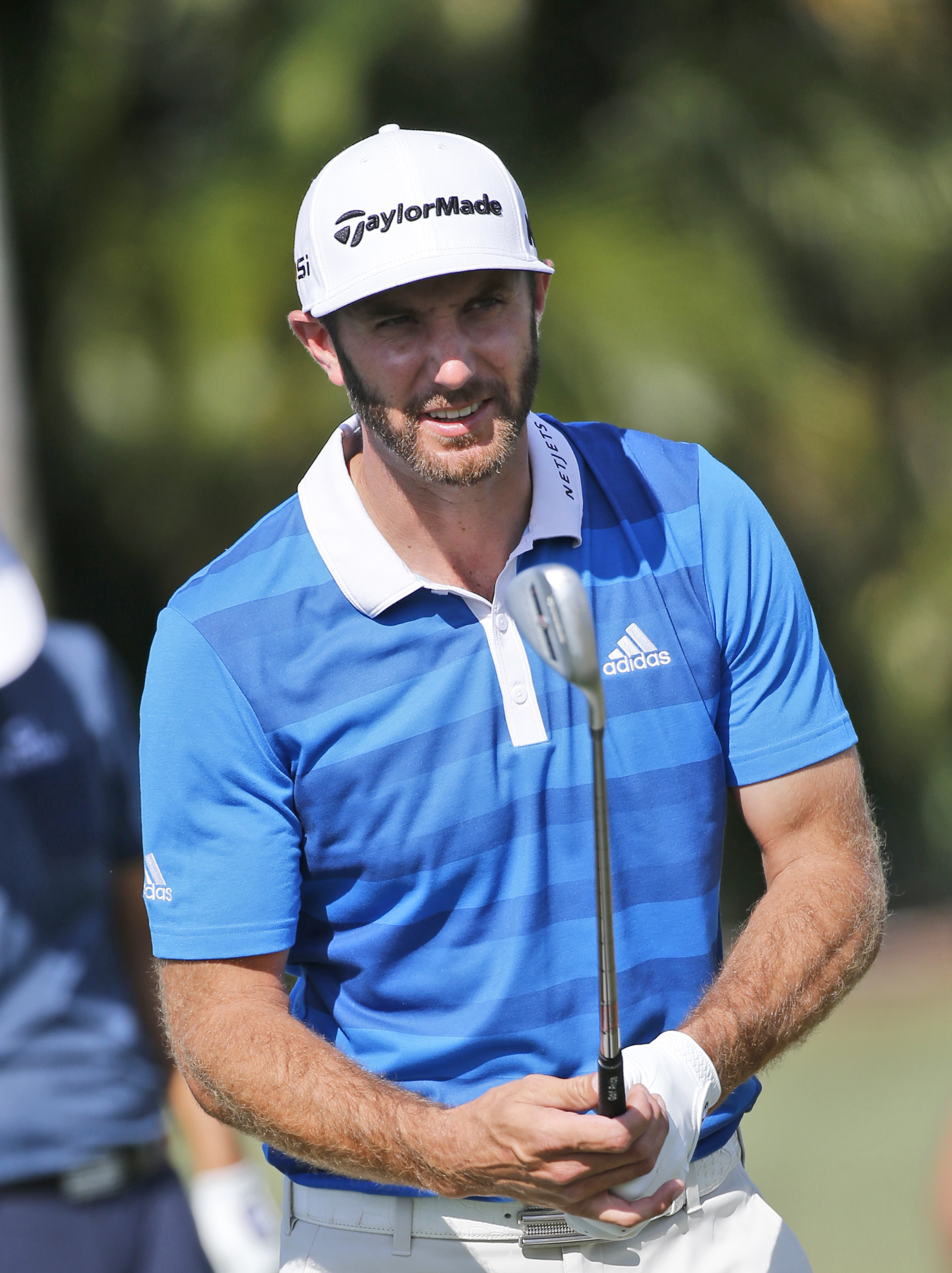 Dustin Johnson prepares to hit on the driving range during a practice day at the Cadillac Championship golf tournament, Wednesday, March 2, 2016, in Doral, Fla. (AP Photo/Wilfredo Lee)