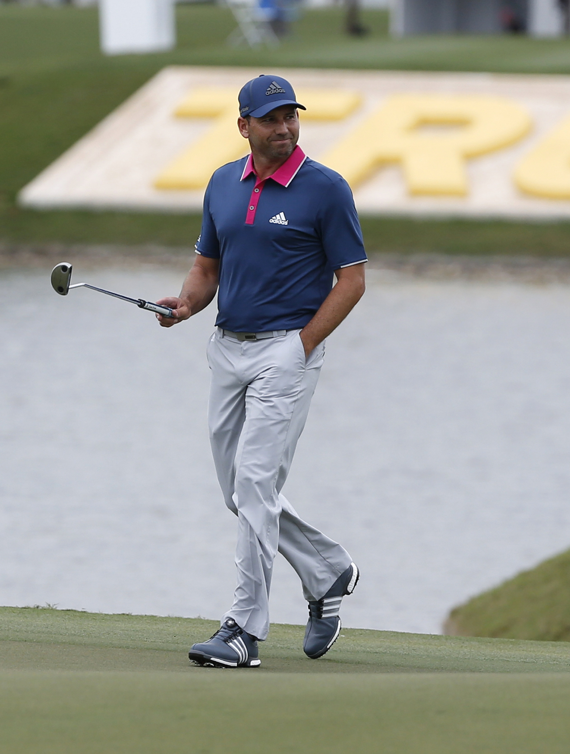 Sergio Garcia, of Spain, acknowledges the cheers from the crowd as he walks onto the ninth green during the first round of the Cadillac Championship golf tournament, Thursday, March 3, 2016, in Doral, Fla. (AP Photo/Wilfredo Lee)