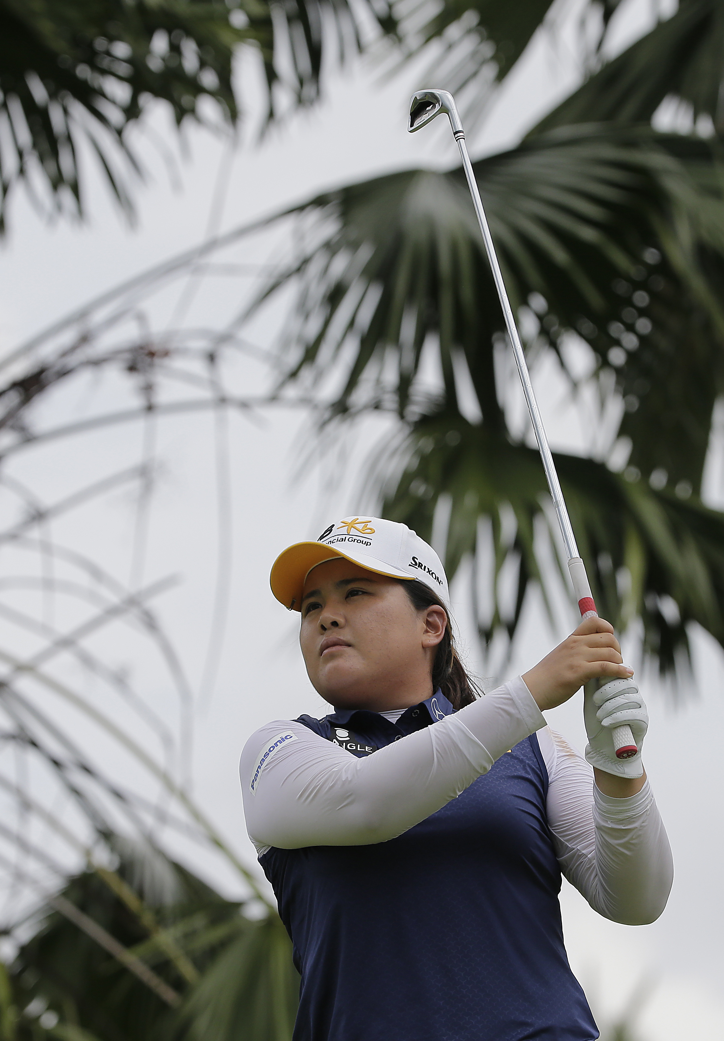 Inbee Park of South Korea watches her tee on the 8th hole during the second round of the HSBC Women's Champions Golf tournament on Friday, March 4, 2016, in Singapore. (AP Photo/Wong Maye-E)
