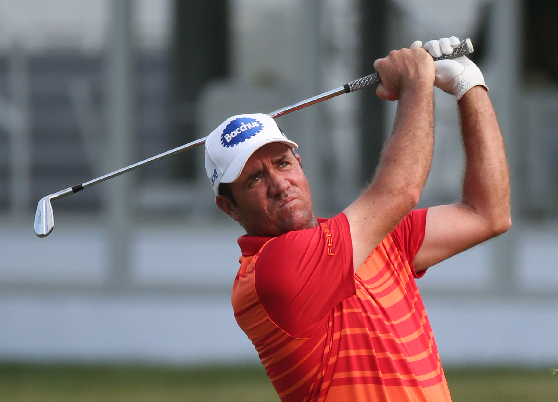 Scott Hend of Australia hits a shot from the fairway on the 17th hole during round 2 at the Hong Kong Open golf tournament in Hong Kong Friday, Oct. 23, 2015. (AP Photo/Kin Cheung)