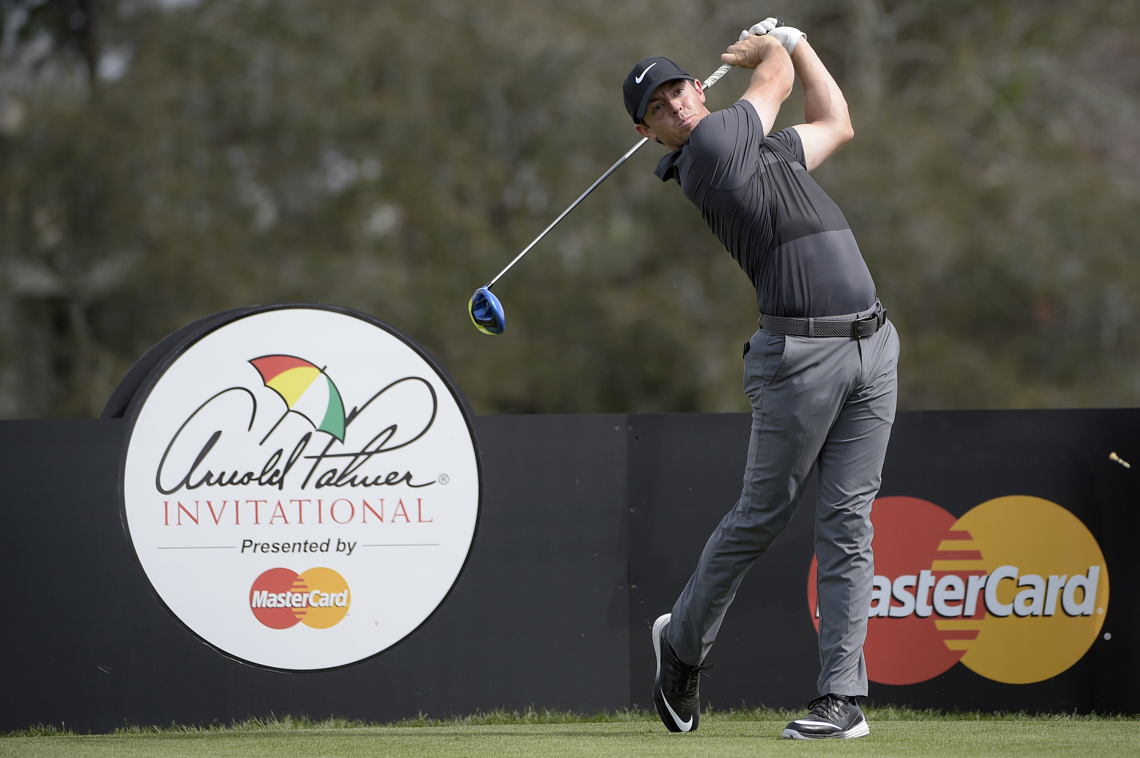 Rory McIlroy, of Northern Ireland, watches his tee shot on the 16th hole during the pro-am of the Arnold Palmer Invitational golf tournament in Orlando, Fla., Wednesday, March 16, 2016. (AP Photo/Phelan M. Ebenhack)