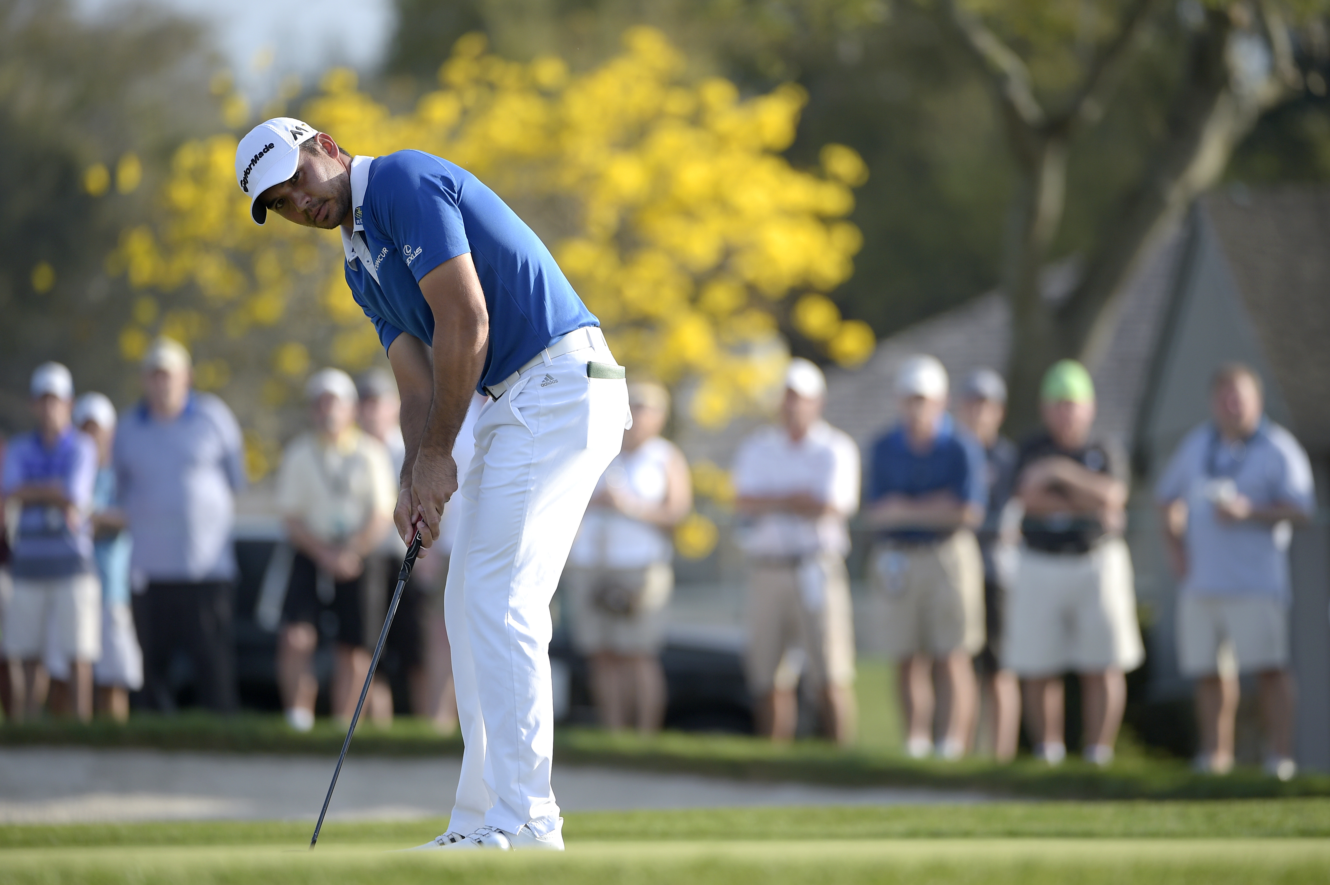 Jason Day, of Australia, watches his putt on the 13th green during the second round of the Arnold Palmer Invitational golf tournament in Orlando, Fla., Friday, March 18, 2016. (AP Photo/Phelan M. Ebenhack)