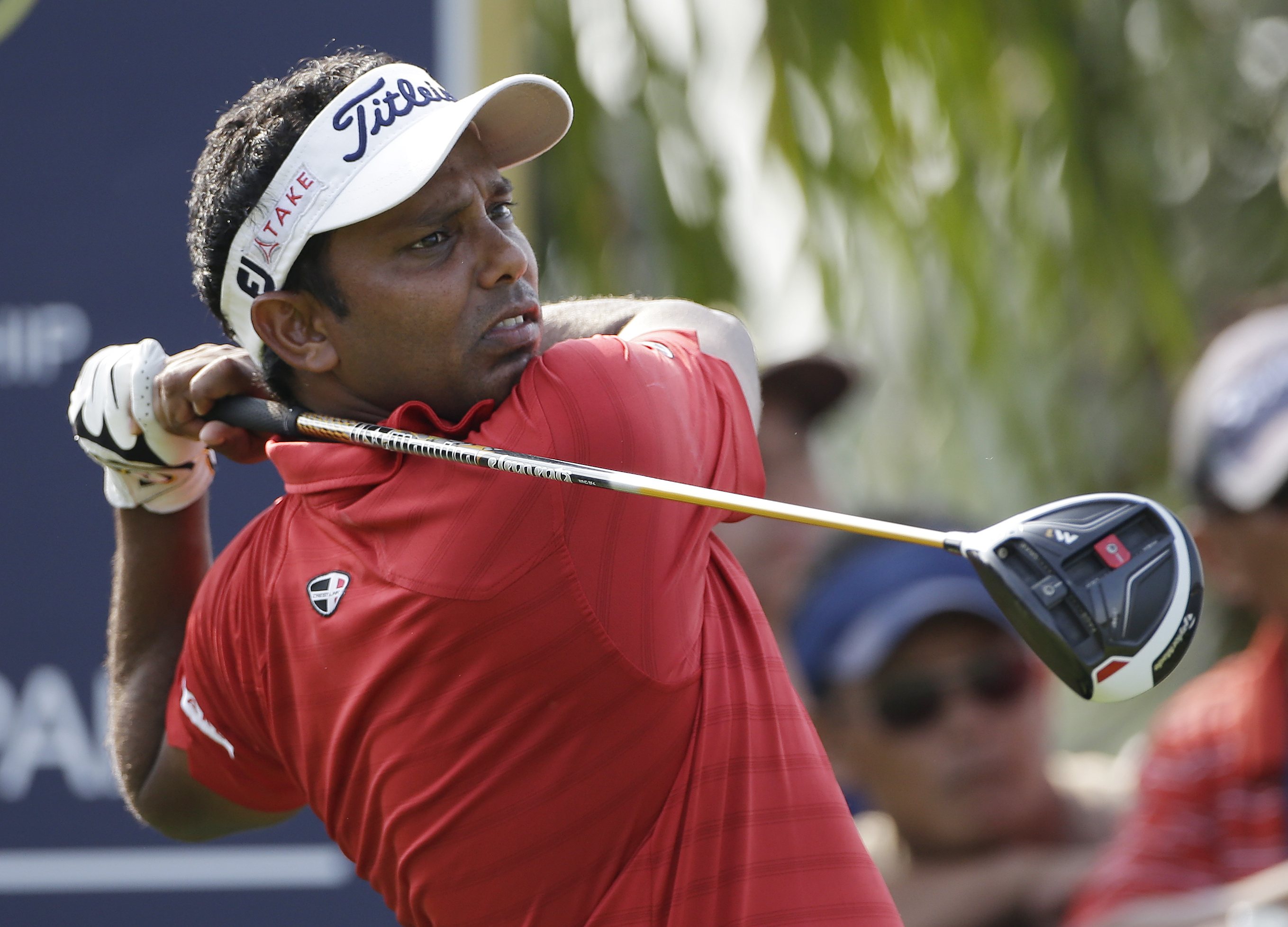 India's S.S.P Chawrasia watches his tee shot on the 18th hole during the final round of the Thailand Golf Championship at Amata Spring Country Club, Chonburi, Thailand, Sunday, Dec. 13, 2015. (AP Photo/Mark Baker)