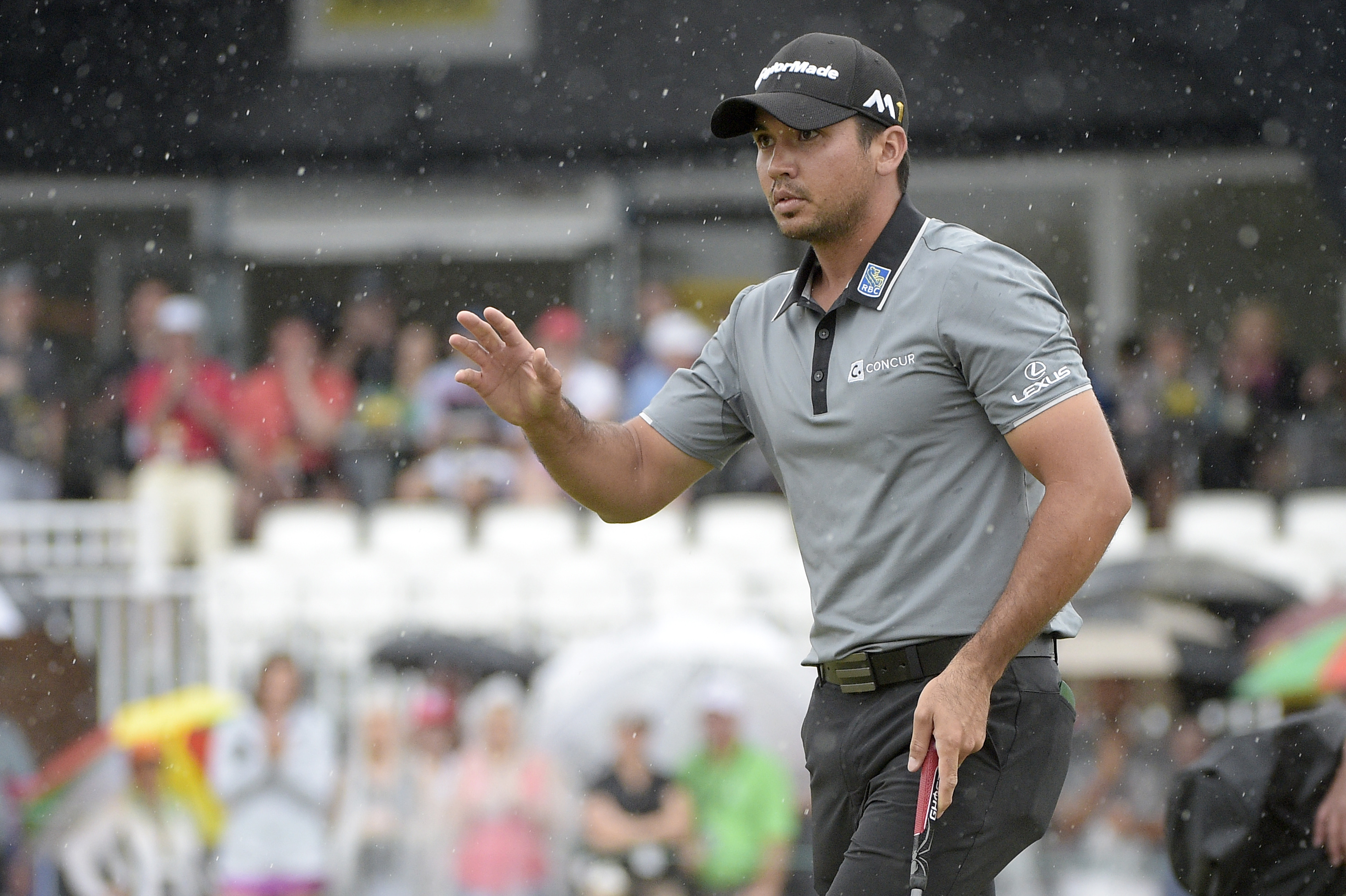 Jason Day, of Australia, acknowledges the crowd after making his putt on the ninth green during the third round of the Arnold Palmer Invitational golf tournament in Orlando, Fla., Saturday, March 19, 2016. (AP Photo/Phelan M. Ebenhack)