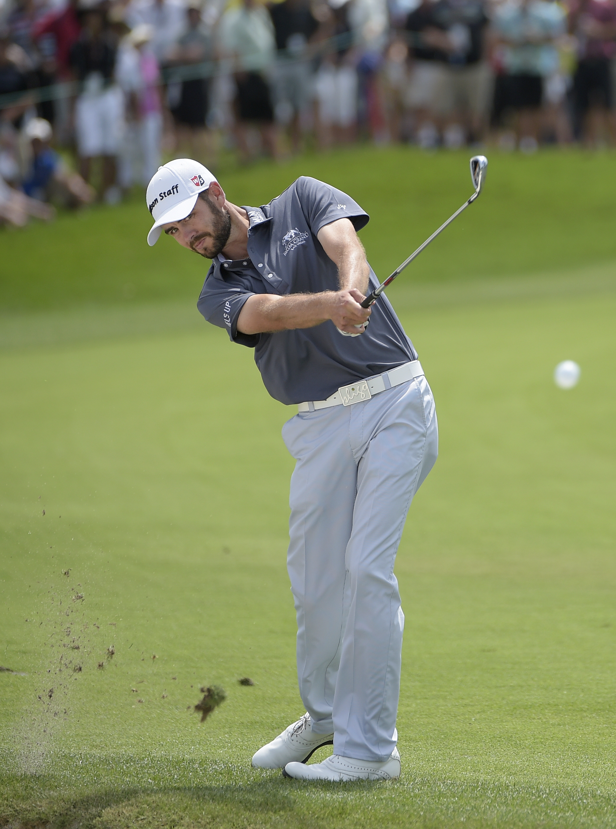 Troy Merritt hits from the first fairway during the final round of the Arnold Palmer Invitational golf tournament in Orlando, Fla., Sunday, March 20, 2016. (AP Photo/Phelan M. Ebenhack)