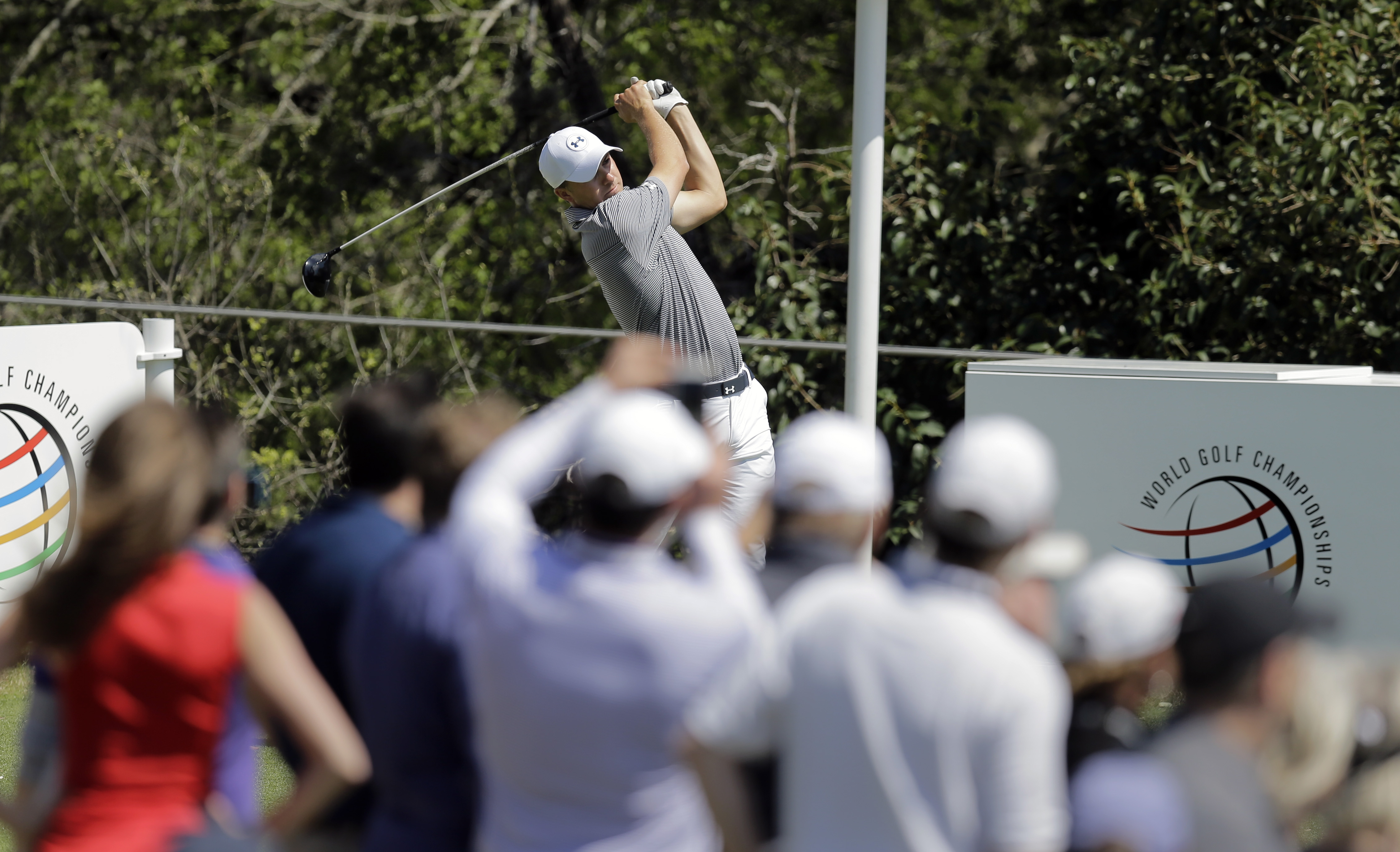 Top seed Jordan Spieth watches his tee shot on the 2nd hole during practice for the Dell Match Play Championship golf tournament at Austin County Club, Tuesday, March 22, 2016, in Austin, Texas. (AP Photo/Eric Gay)