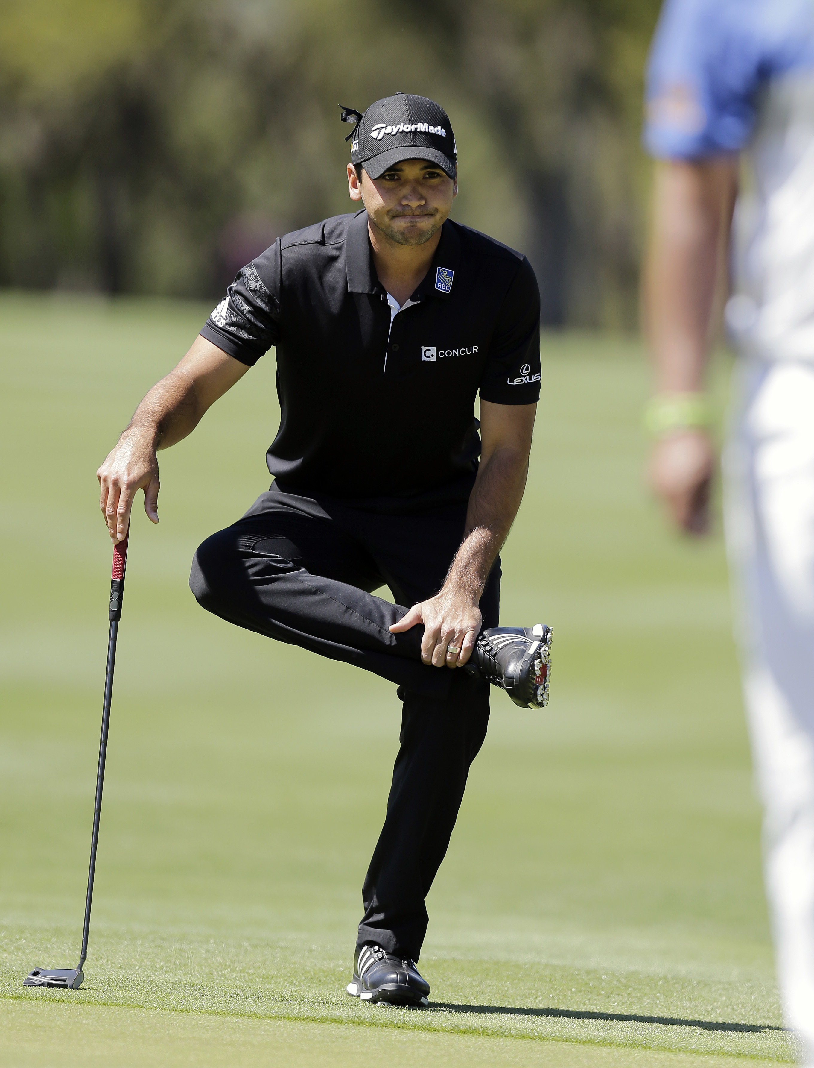 Jason Day, of Australia, stretches as he waits to putt on the first hole during round-robin play against Thongchai Jaidee at the Dell Match Play Championship golf tournament at Austin County Club, Thursday, March 24, 2016, in Austin, Texas. (AP Photo/Eric