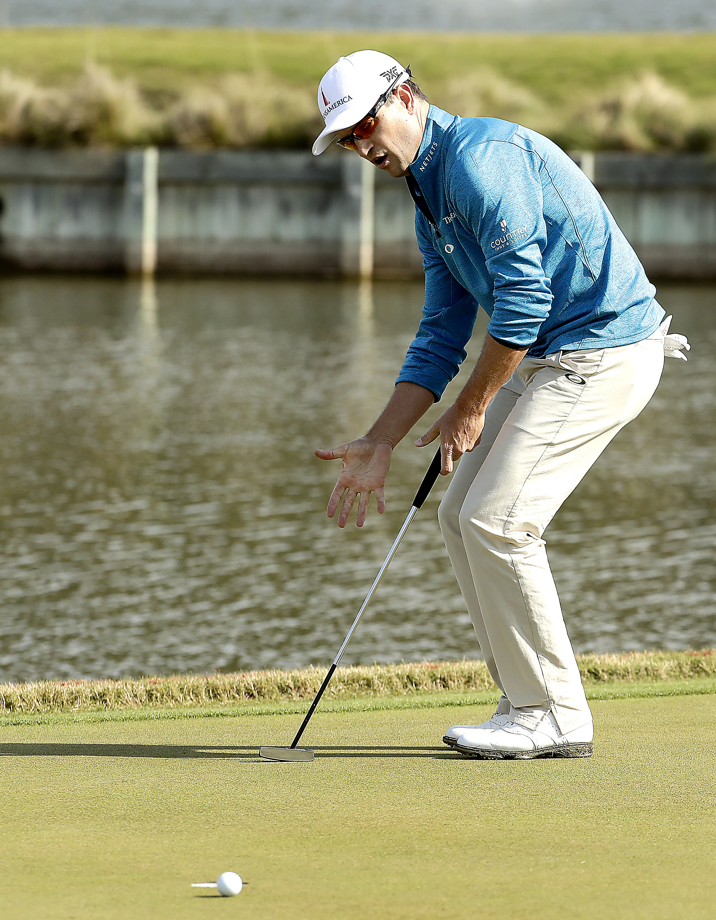 Zach Johnson reacts after missing a putt on the 13th green during the round of 16 play against Rory McIlroy at the Dell Match Play Championship golf tournament at Austin County Club Saturday, March 26, 2016, in Austin, Texas. (AP Photo/Charlie Riedel)