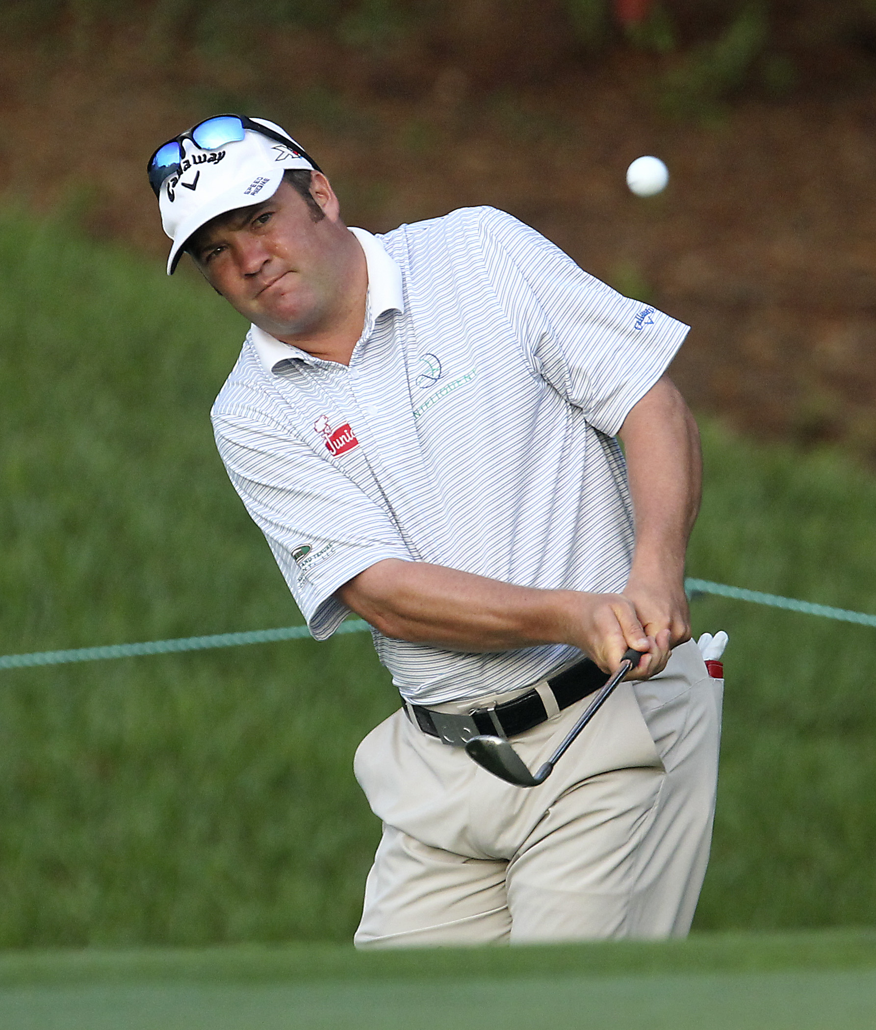 Andrew Svoboda chips onto the second green during the first round of the Arnold Palmer Invitational golf tournament in Orlando, Fla., Thursday, March 19, 2015.(AP Photo/Reinhold Matay)