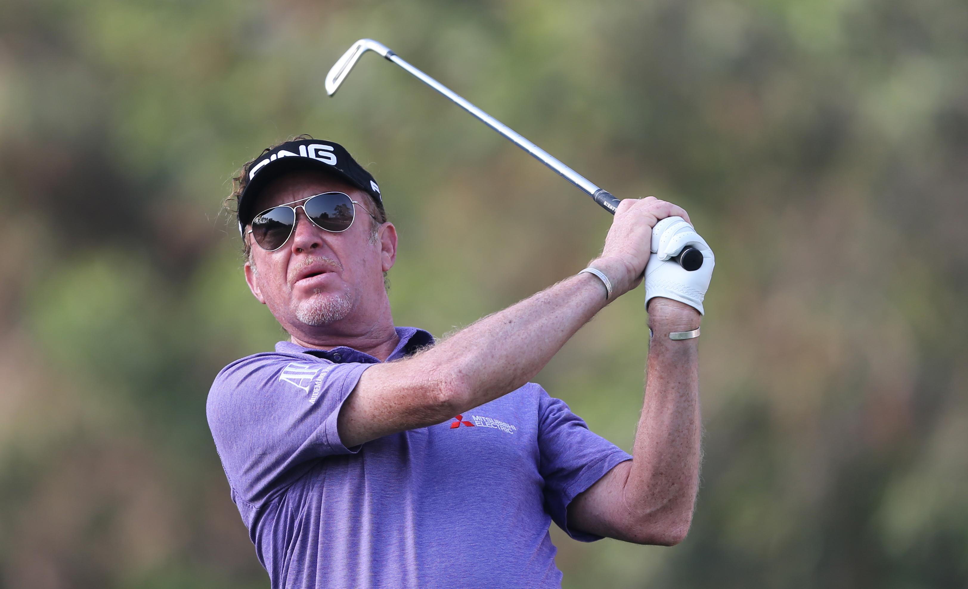 Miguel Angel Jimenez of Spain plays a shot on the 11th hole during 1st round of the Omega Dubai Desert Classic golf tournament in Dubai, United Arab Emirates, Thursday, Feb. 4, 2016. (AP Photo/Kamran Jebreili)