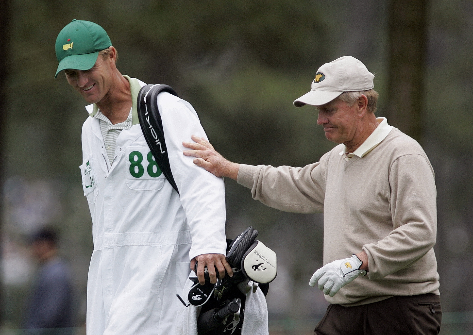 FILE - In this April 9, 2005, file photo, Jack Nicklaus, right, walks with his son and caddie, Jack Nicklaus II, on the ninth hole during second round play of the Masters golf tournament at the Augusta National Golf Club in Augusta, Ga. Nicklaus oldest so