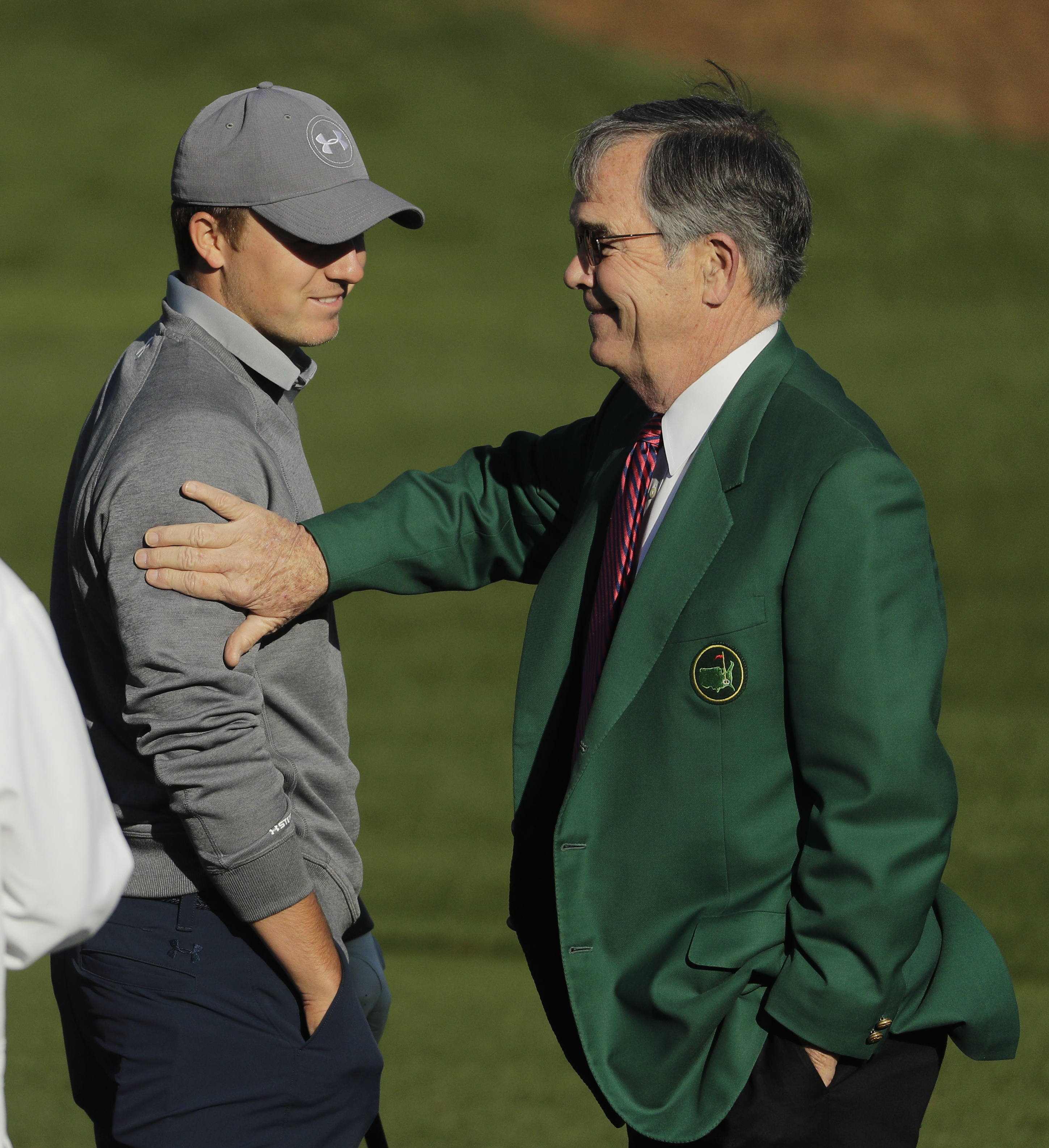 Billy Payne, right, Chairman of Augusta National Golf Club, speaks with Jordan Spieth on the driving range during a practice round for the Masters golf tournament, Tuesday, April 5, 2016, in Augusta, Ga. (AP Photo/Chris Carlson)