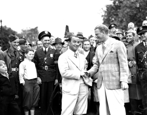 FILE - In this April 8, 1935, file photo, Gene Sarazen, left, is congratulated by Craig Wood at the end of their 36-hole playoff game of the Masters Championship at Augusta National Golf Club in Augusta, Ga. Sarazen won 144 to 149. Wood endured more heart