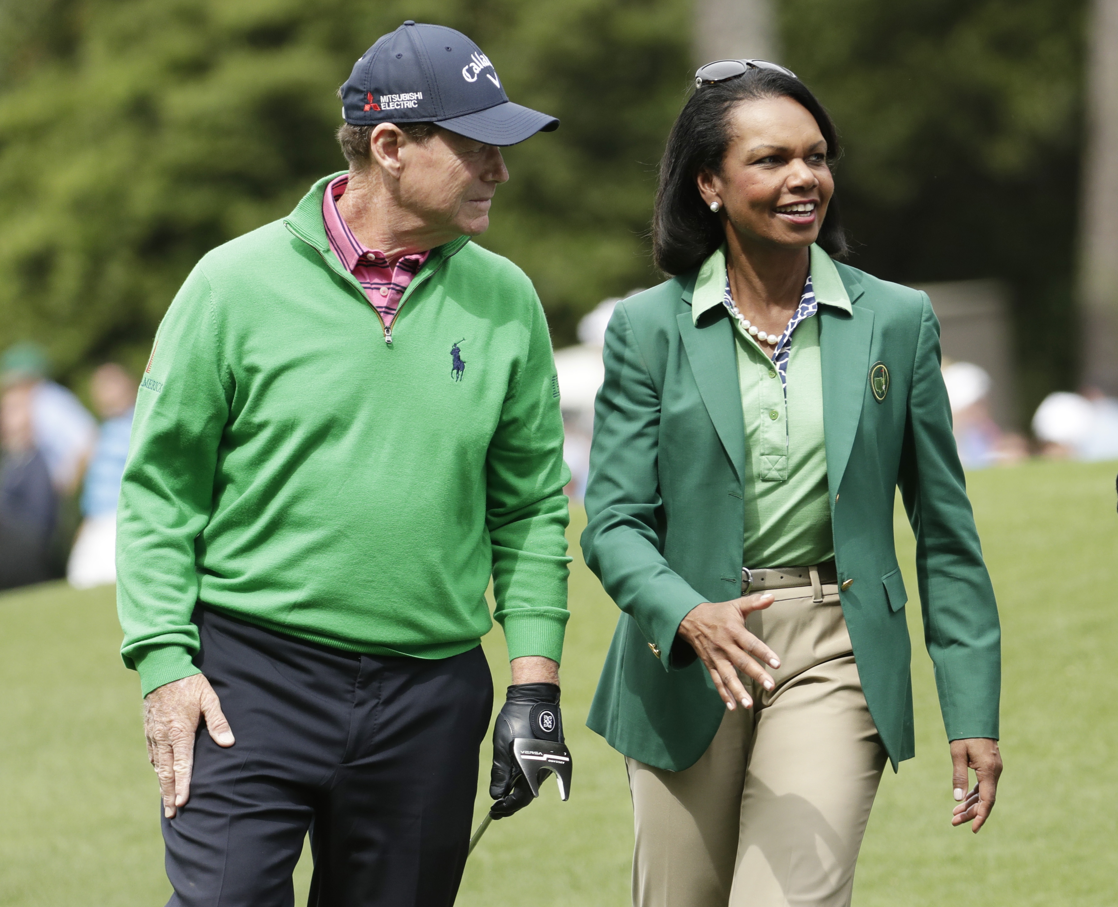 Former Secretary of State Condoleeza Rice speaks with Tom Watson during the par three competition at the Masters golf tournament Wednesday, April 6, 2016, in Augusta, Ga. (AP Photo/Charlie Riedel)