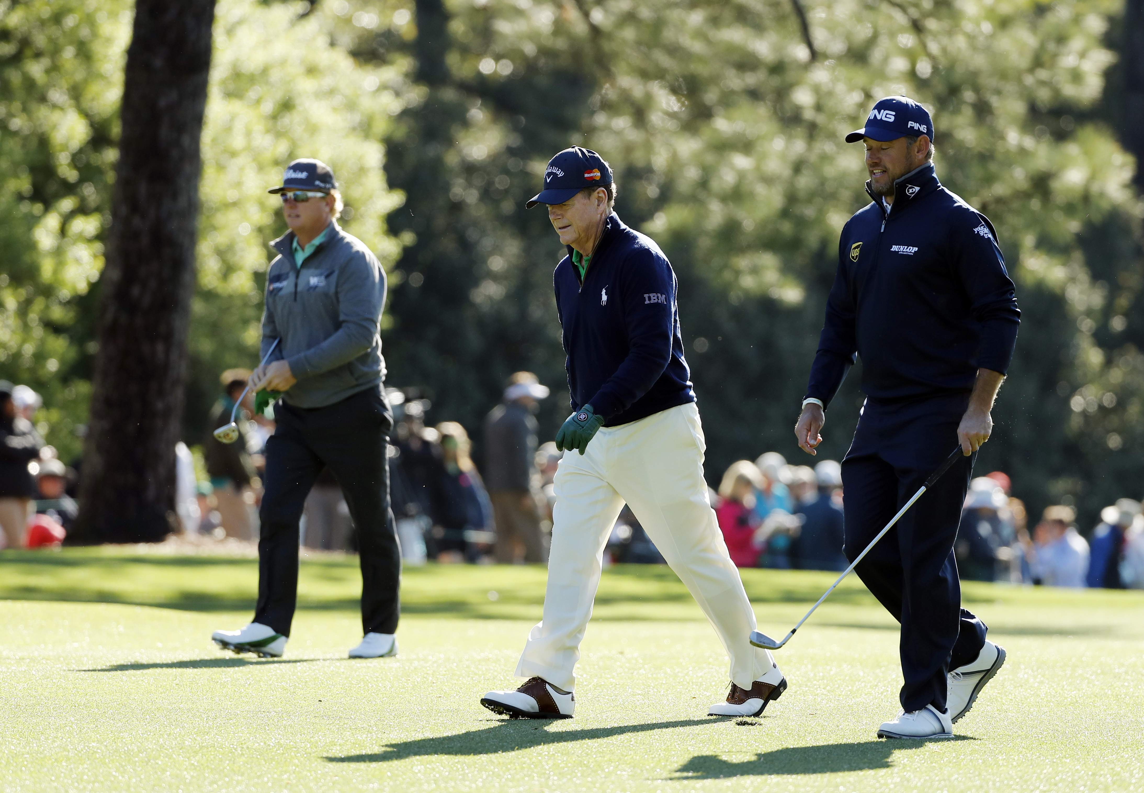 Tom Watson, center, walks with Charley Hoffman, left and Lee Westwood, of England, on the first fairway during the first round of the Masters golf tournament Thursday, April 7, 2016, in Augusta, Ga. (AP Photo/Matt Slocum)