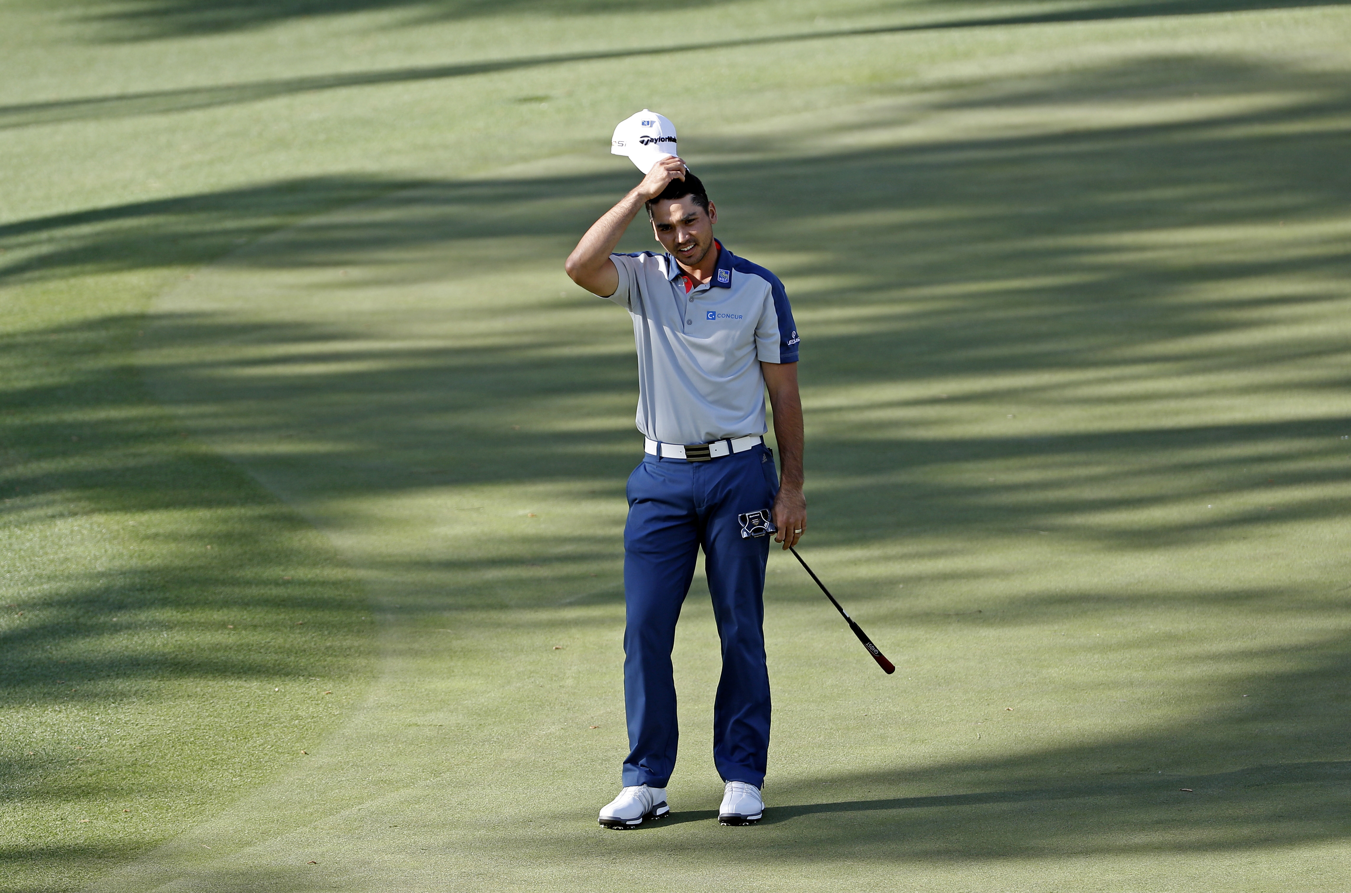Jason Day, of Australia, reacts to his missed birdie putt on the 15th hole during the first round of the Masters golf tournament Thursday, April 7, 2016, in Augusta, Ga. (AP Photo/David J. Phillip)