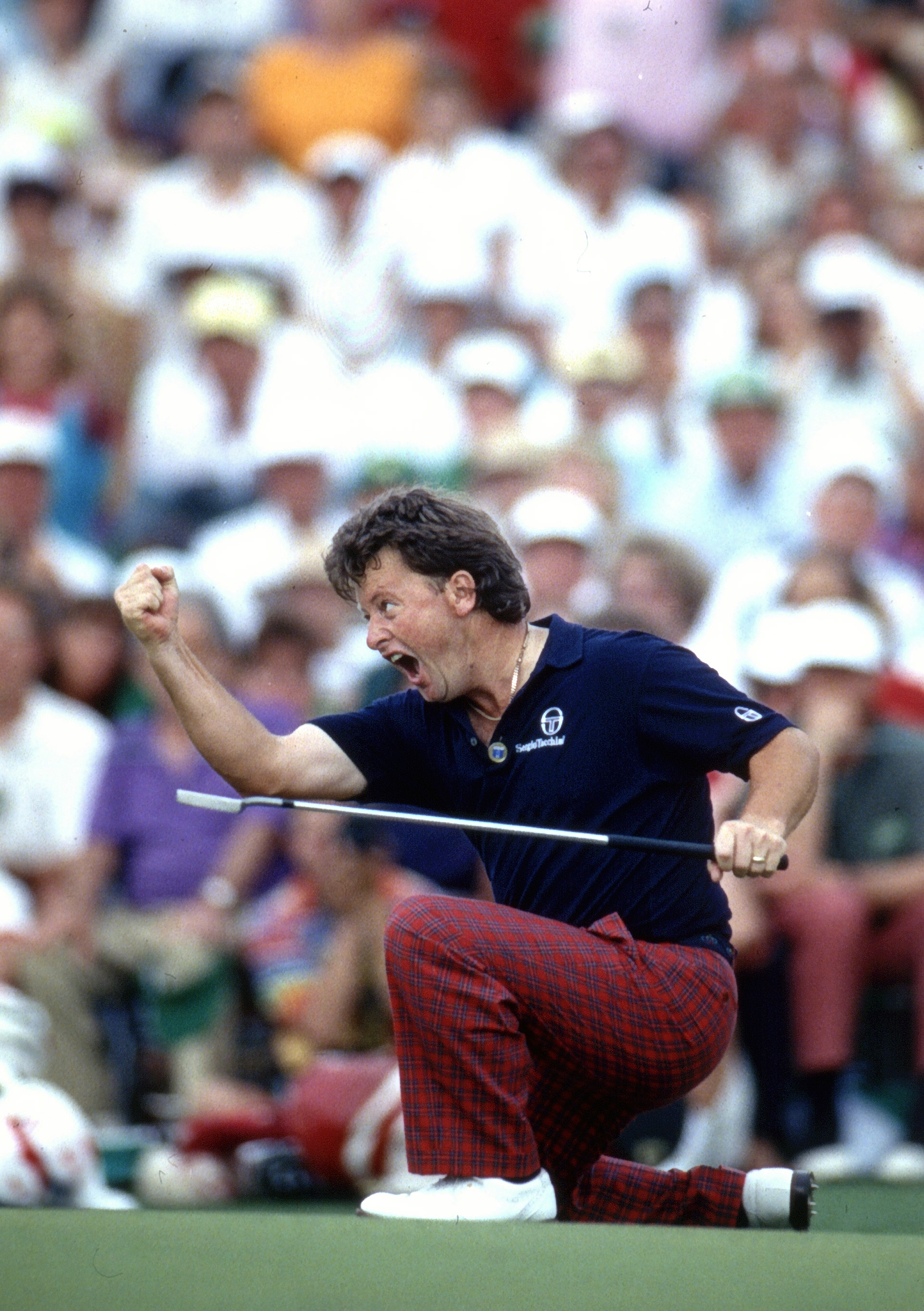 FILE - In this April 14, 1991 file photo, Ian Woosnam, from Wales, reacts to his putt for par on the 18th green to win the Masters golf tournament at the Augusta National Golf Club in Augusta, Ga. A quarter century after winning the Masters, Woosnam has p