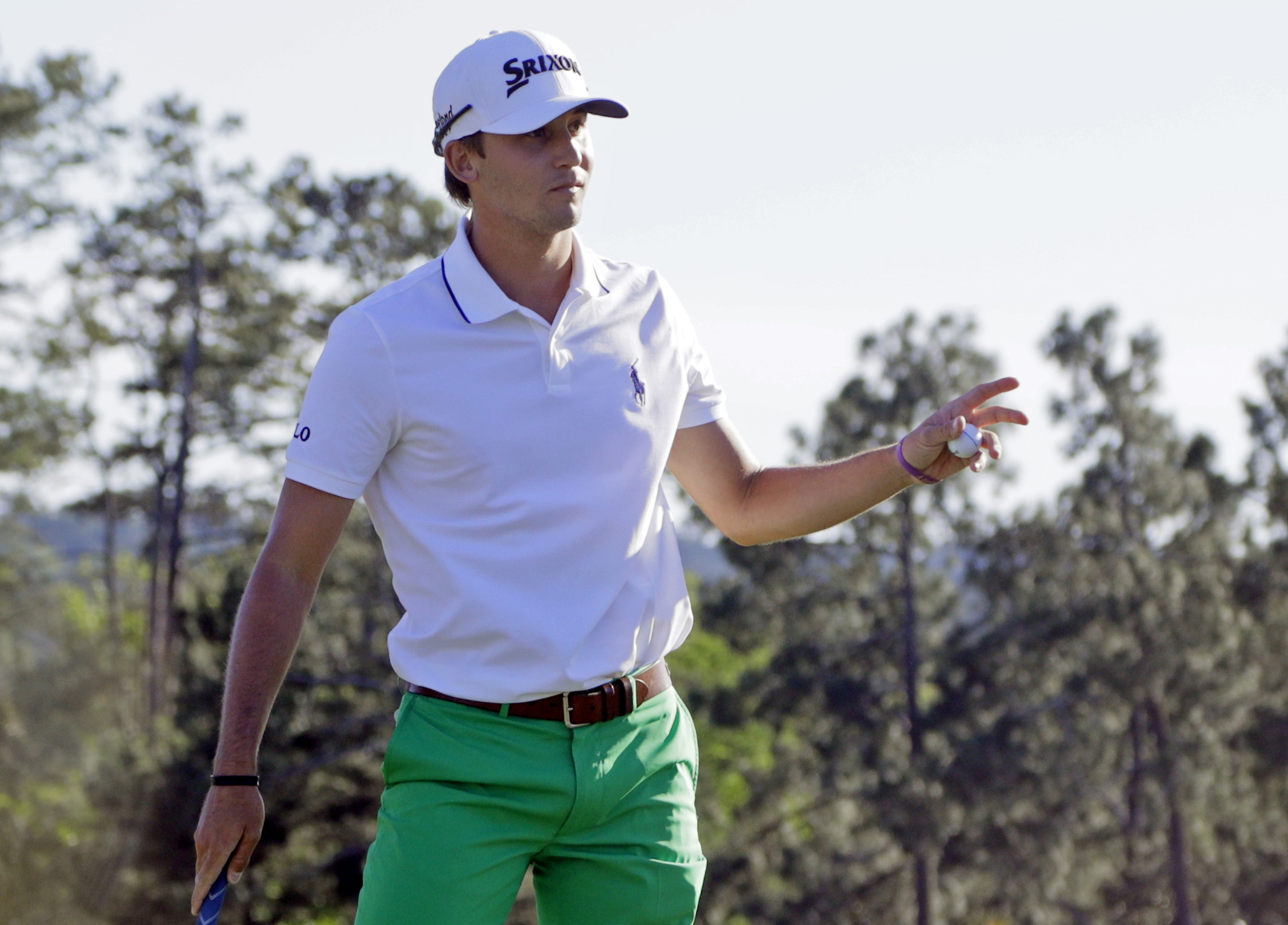 Smylie Kaufman holds up his ball after putting out on the 18th green during the third round of the Masters golf tournament Saturday, April 9, 2016, in Augusta, Ga. (AP Photo/Jae C. Hong)