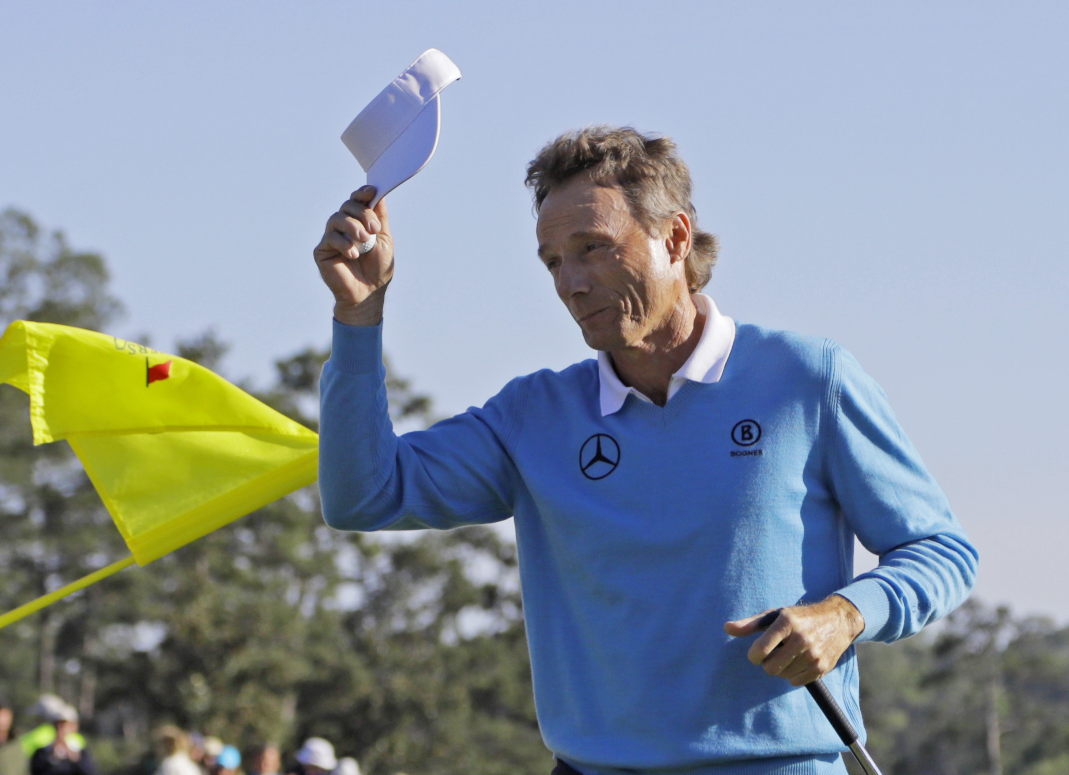 Bernhard Langer, of Germany, tips his cap after putting out on the 18th hole during the third round of the Masters golf tournament Saturday, April 9, 2016, in Augusta, Ga. (AP Photo/Jae C. Hong)