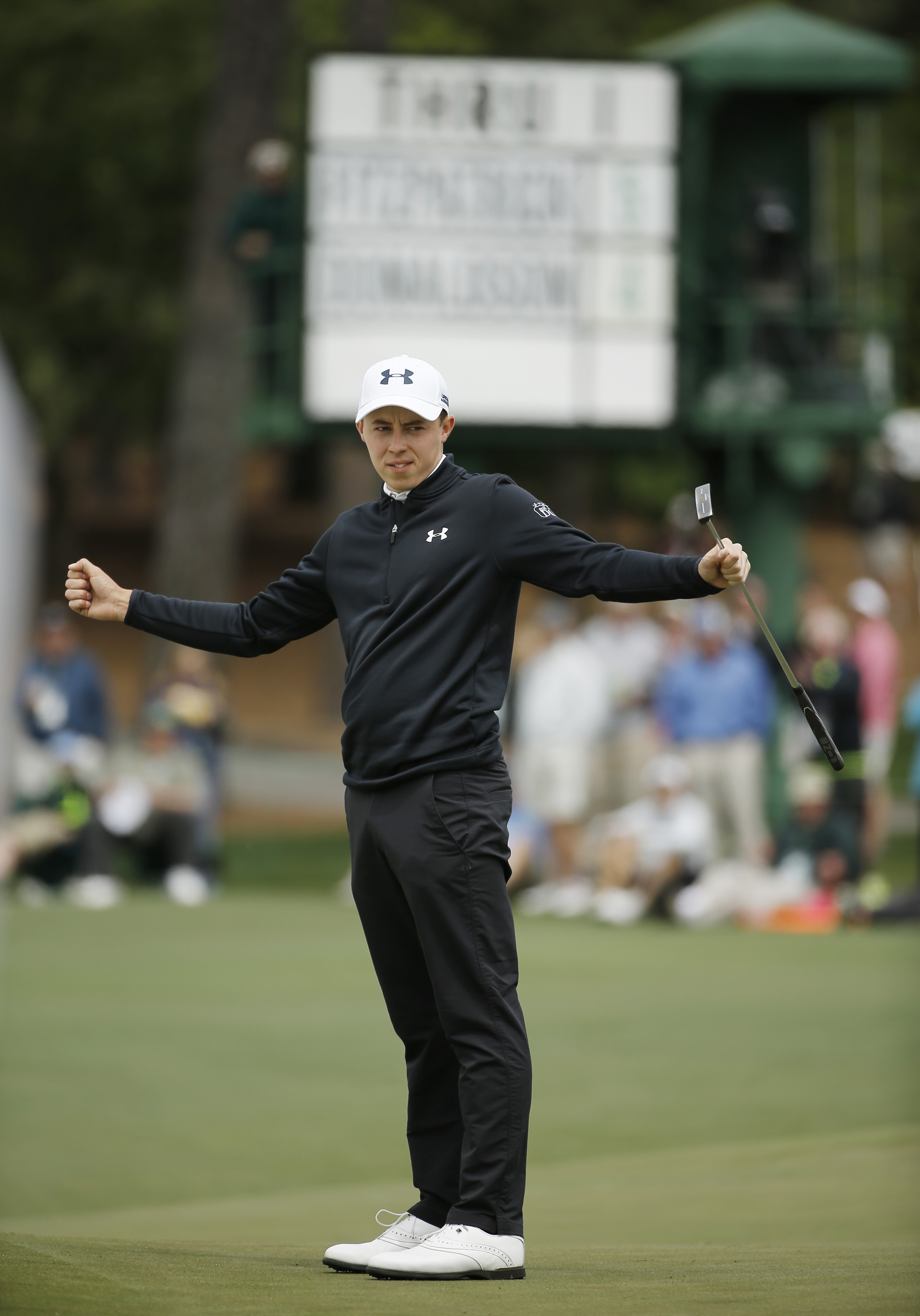 Matthew Fitzpatrick, of England, reacts to his putt on the second green during the final round of the Masters golf tournament Sunday, April 10, 2016, in Augusta, Ga. (AP Photo/Matt Slocum)