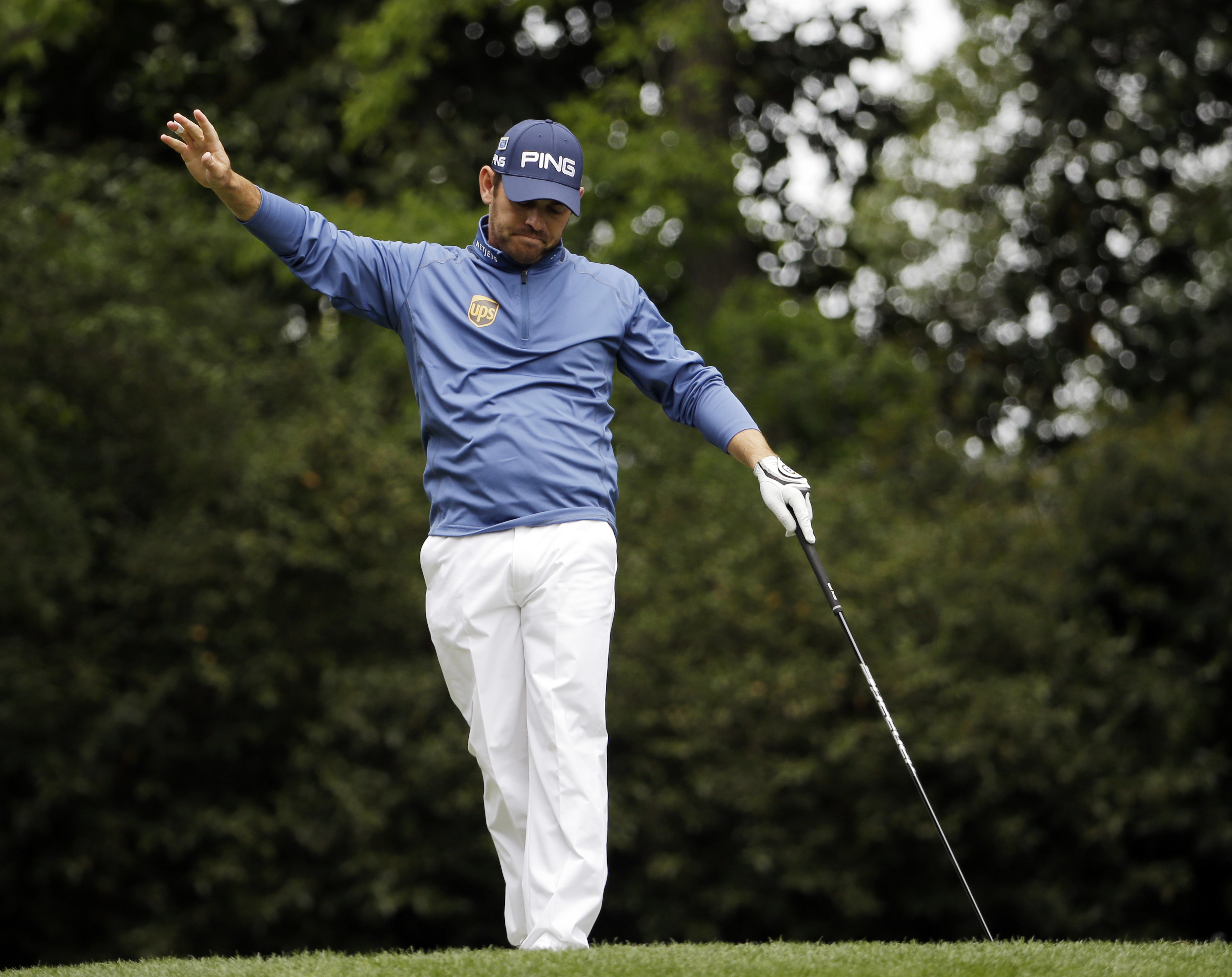 Louis Oosthuizen, of South Africa, reacts after teeing off on the second hole during the final round of the Masters golf tournament Sunday, April 10, 2016, in Augusta, Ga. (AP Photo/David J. Phillip)