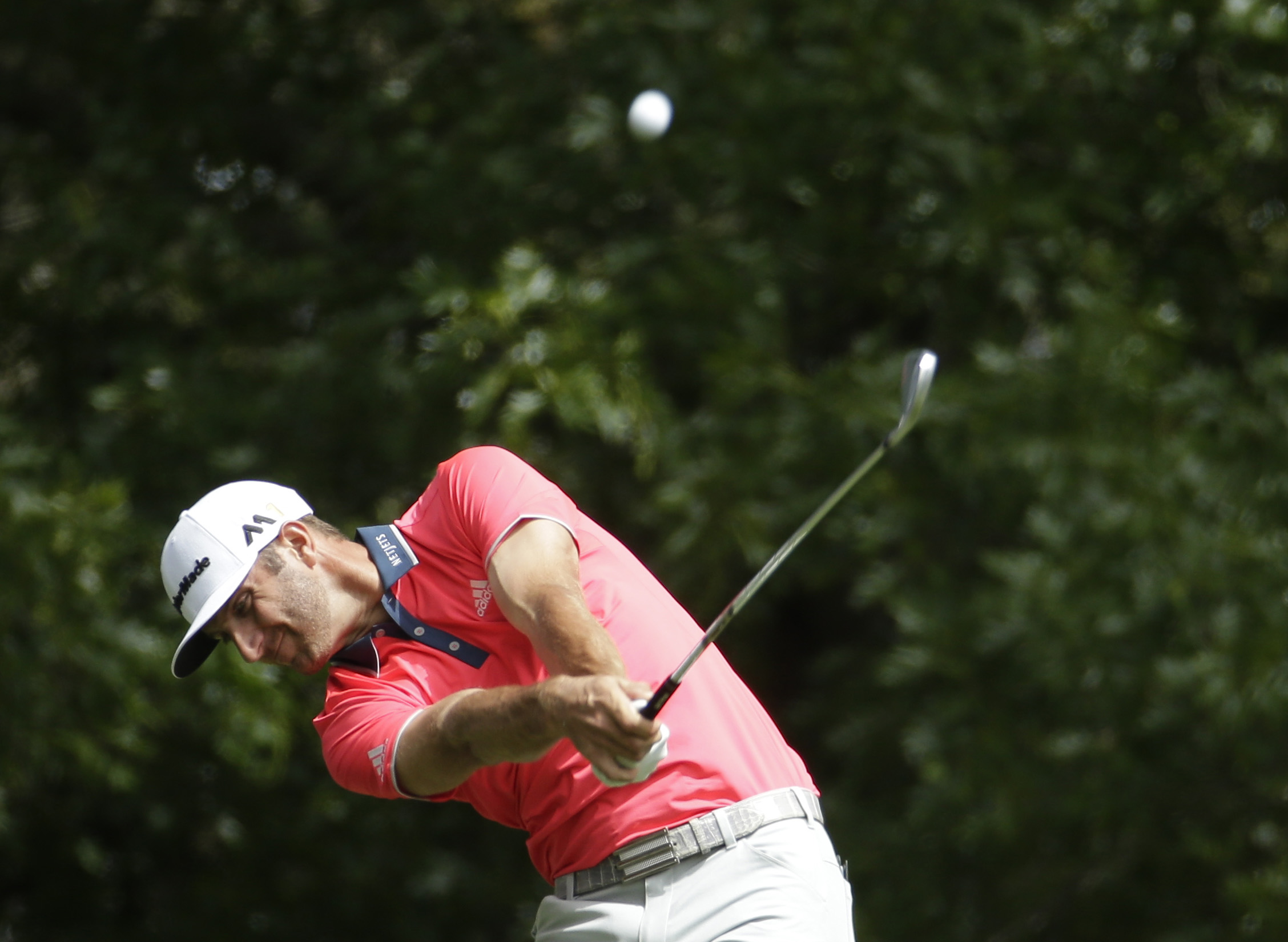 Dustin Johnson tees off on the fourth hole during the final round of the Masters golf tournament Sunday, April 10, 2016, in Augusta, Ga. (AP Photo/Charlie Riedel)
