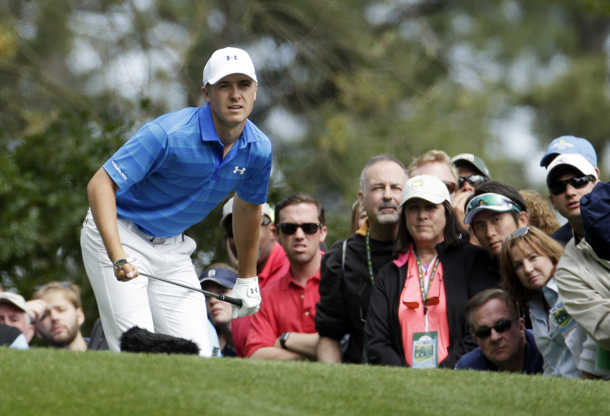 Jordan Spieth watches his tee shot on the fourth hole during the final round of the Masters golf tournament Sunday, April 10, 2016, in Augusta, Ga. (AP Photo/Charlie Riedel)