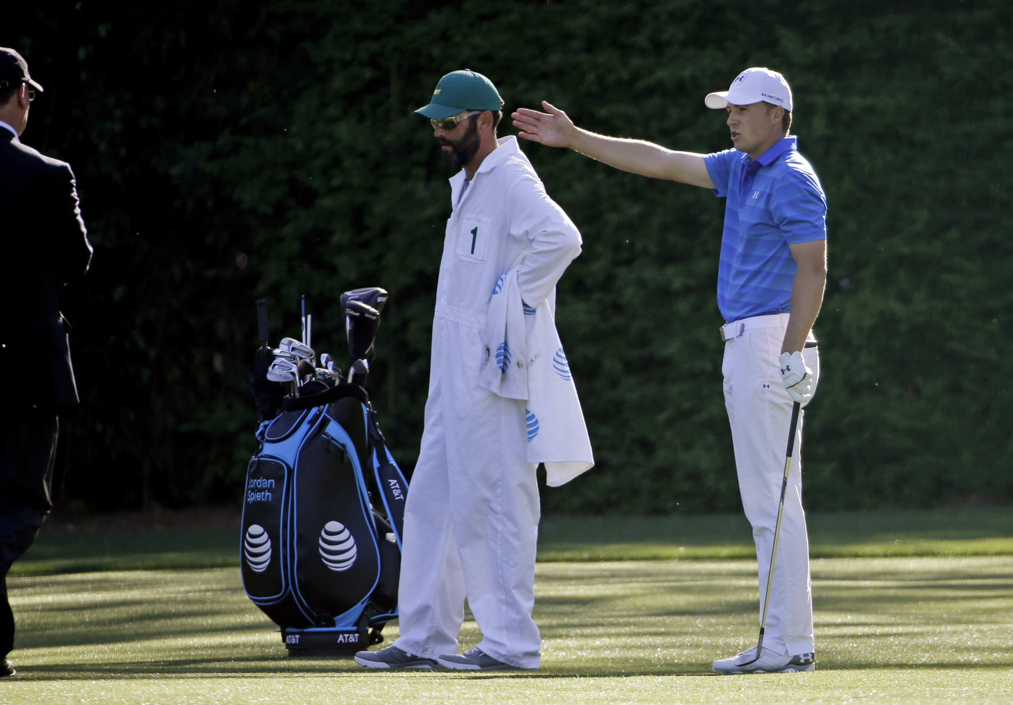 Jordan Spieth discuss his shot after his second drop on the 12th fairway after putting his ball in the water twice during the final round of the Masters golf tournament Sunday, April 10, 2016, in Augusta, Ga. (AP Photo/David J. Phillip)