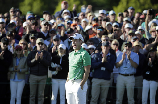 Danny Willett, of England, stands on the 18th hole after finishing the final round of the Masters golf tournament Sunday, April 10, 2016, in Augusta, Ga. (AP Photo/Charlie Riedel)