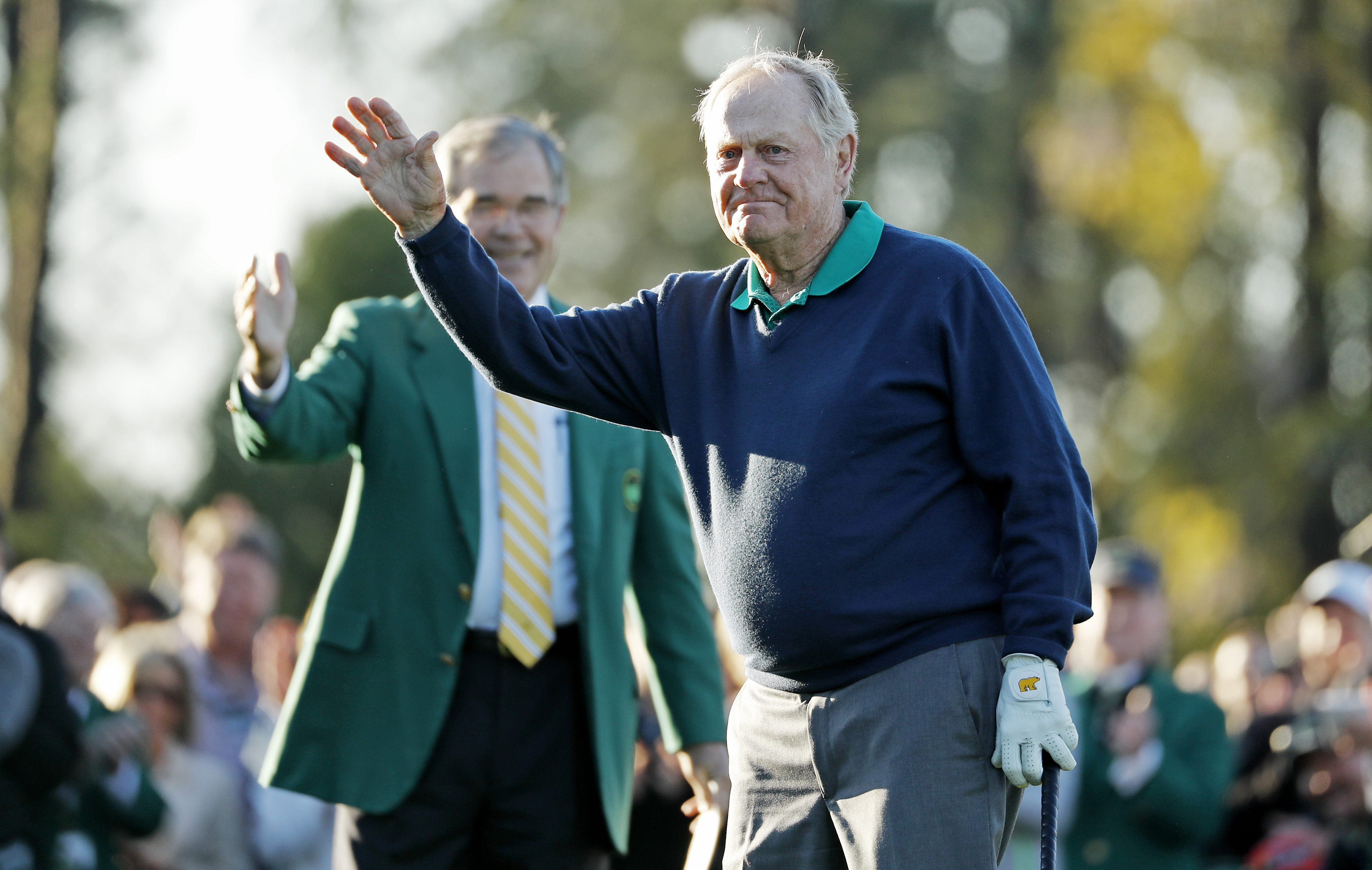 Jack Nicklaus waves before hitting a ceremonial first tee before the first round of the Masters golf tournament Thursday, April 7, 2016, in Augusta, Ga. Behind his Billy Payne, CEO and Chairman of Augusta National Golf Course. (AP Photo/Matt Slocum)