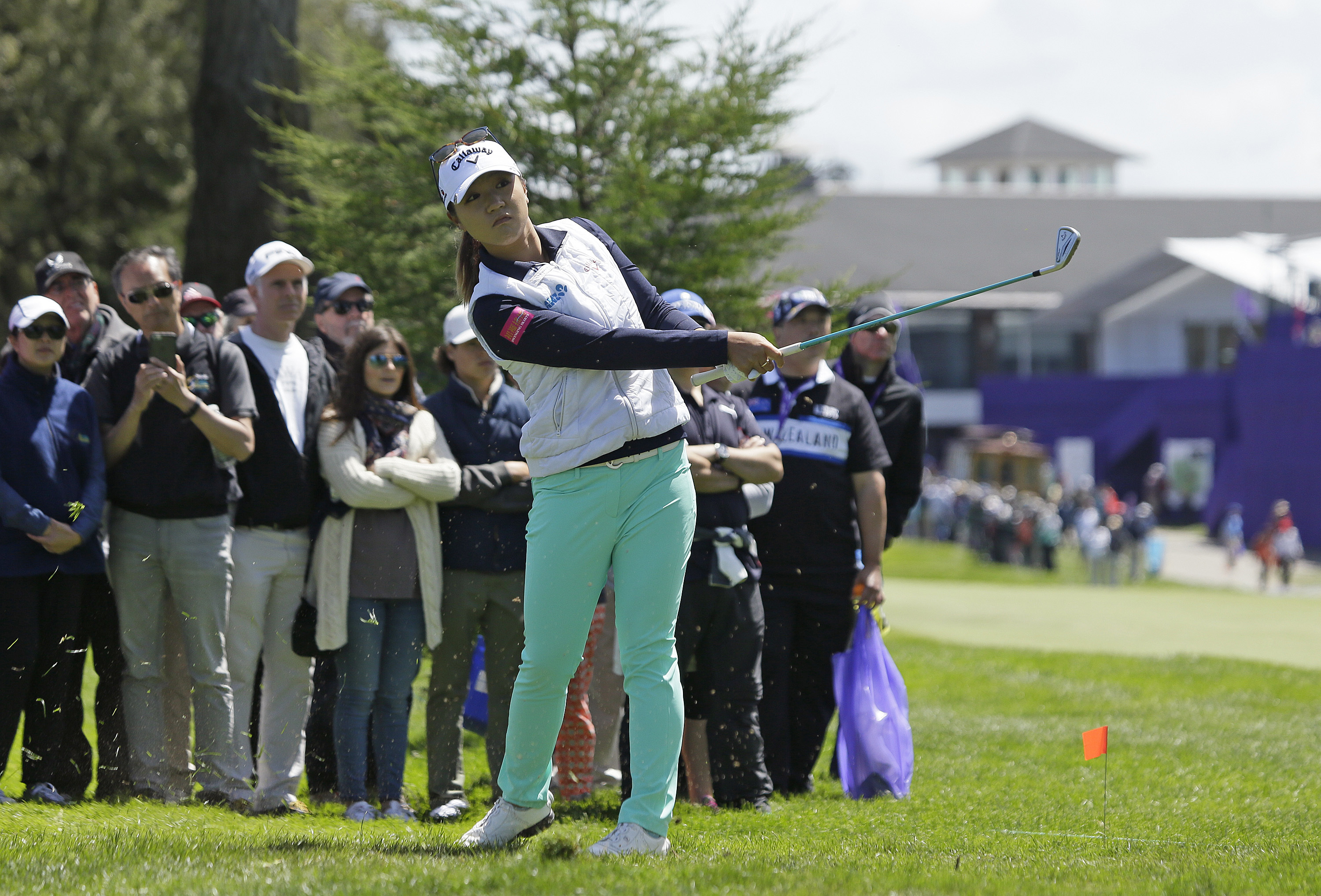 Lydia Ko, of New Zealand, hits from off the first fairway of the Lake Merced Golf Club during the third round of the Swinging Skirts LPGA Classic golf tournament Saturday, April 23, 2016, in Daly City, Calif. (AP Photo/Eric Risberg)